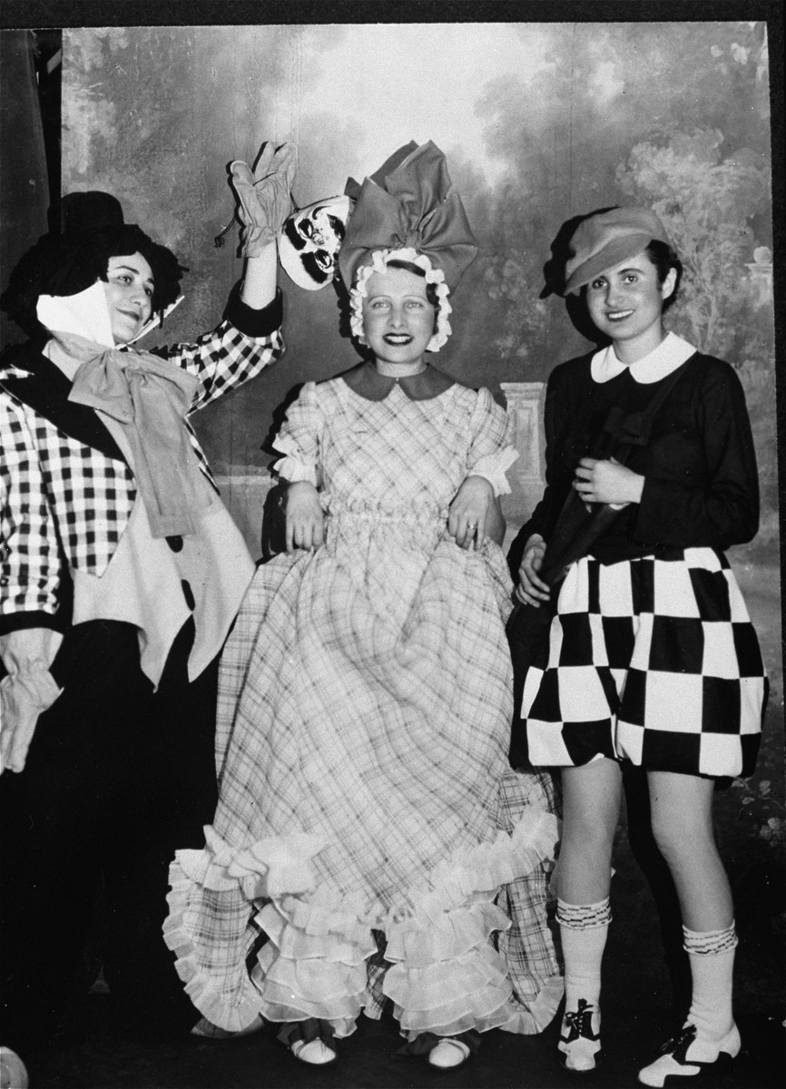 Magda Fisgrund Ginsberger and her friends at a masquerade ball.