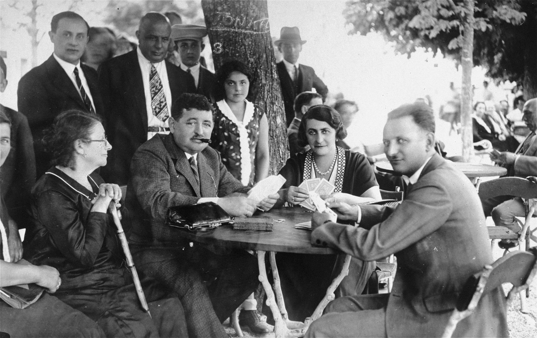 Members of the Gruenwald family play cards outside at a vacation resort in Croatia.