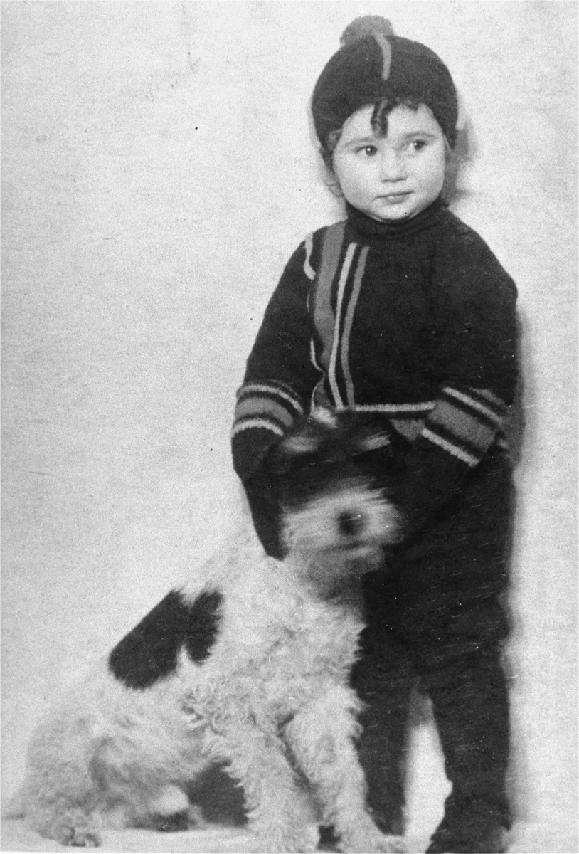Liane Reif poses in winter clothes next to her dog.