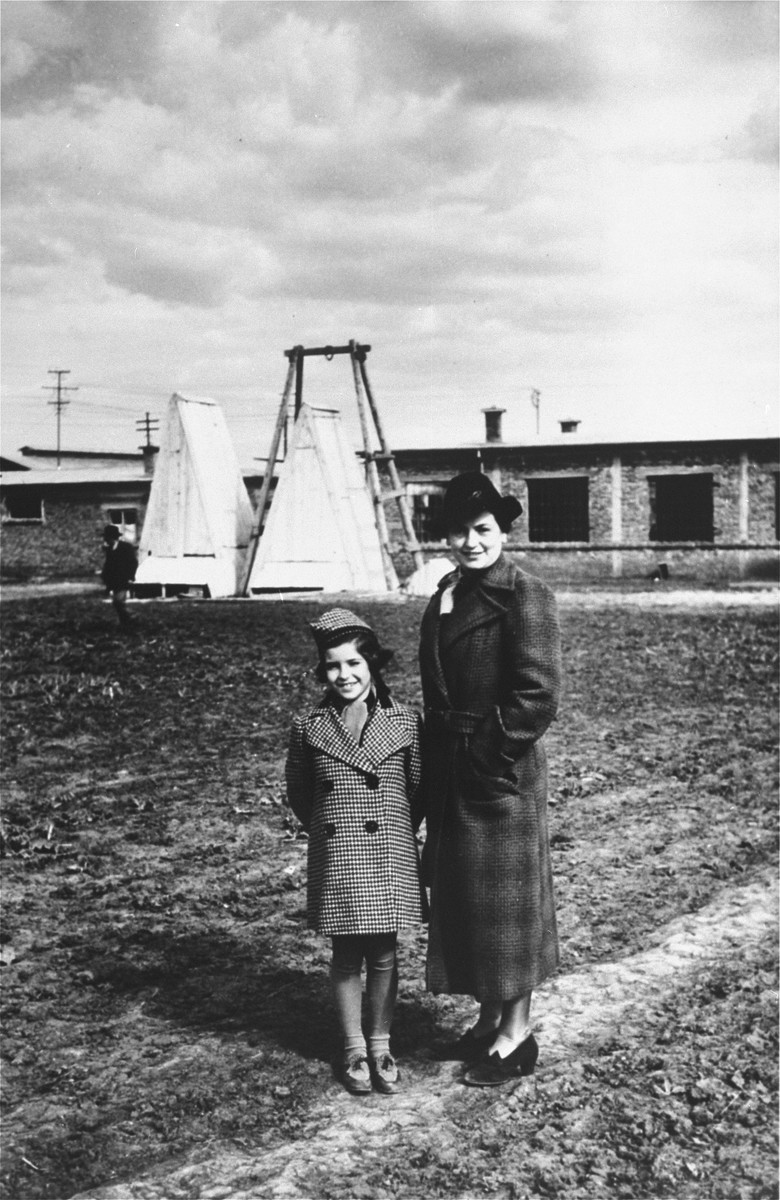 Blanka and Marta Kupfermann pose on the grounds of the wood processing plant built by Beno Kupfermann in Gugesti, Romania.