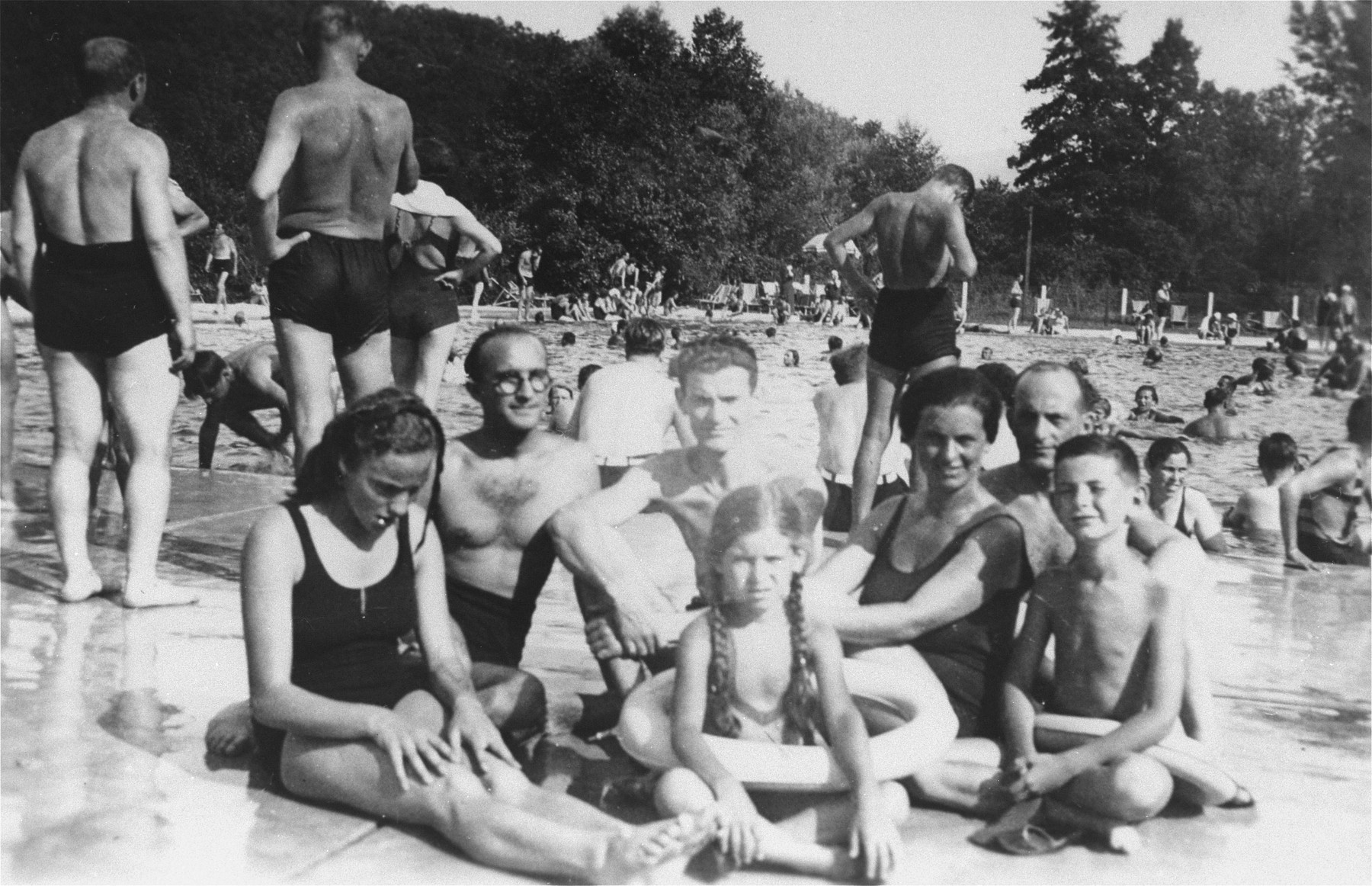 A Jewish family poses next to a swimming pool in Zagreb, Croatia.  Among those pictured are Marta and Aurel Kupfermann (the two children) and their mother, Blanka (next to Aurel).