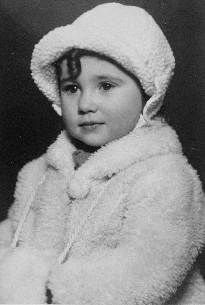 Portrait of an Austrian-Jewish girl in a winter coat.  Pictured is Liane Rief.