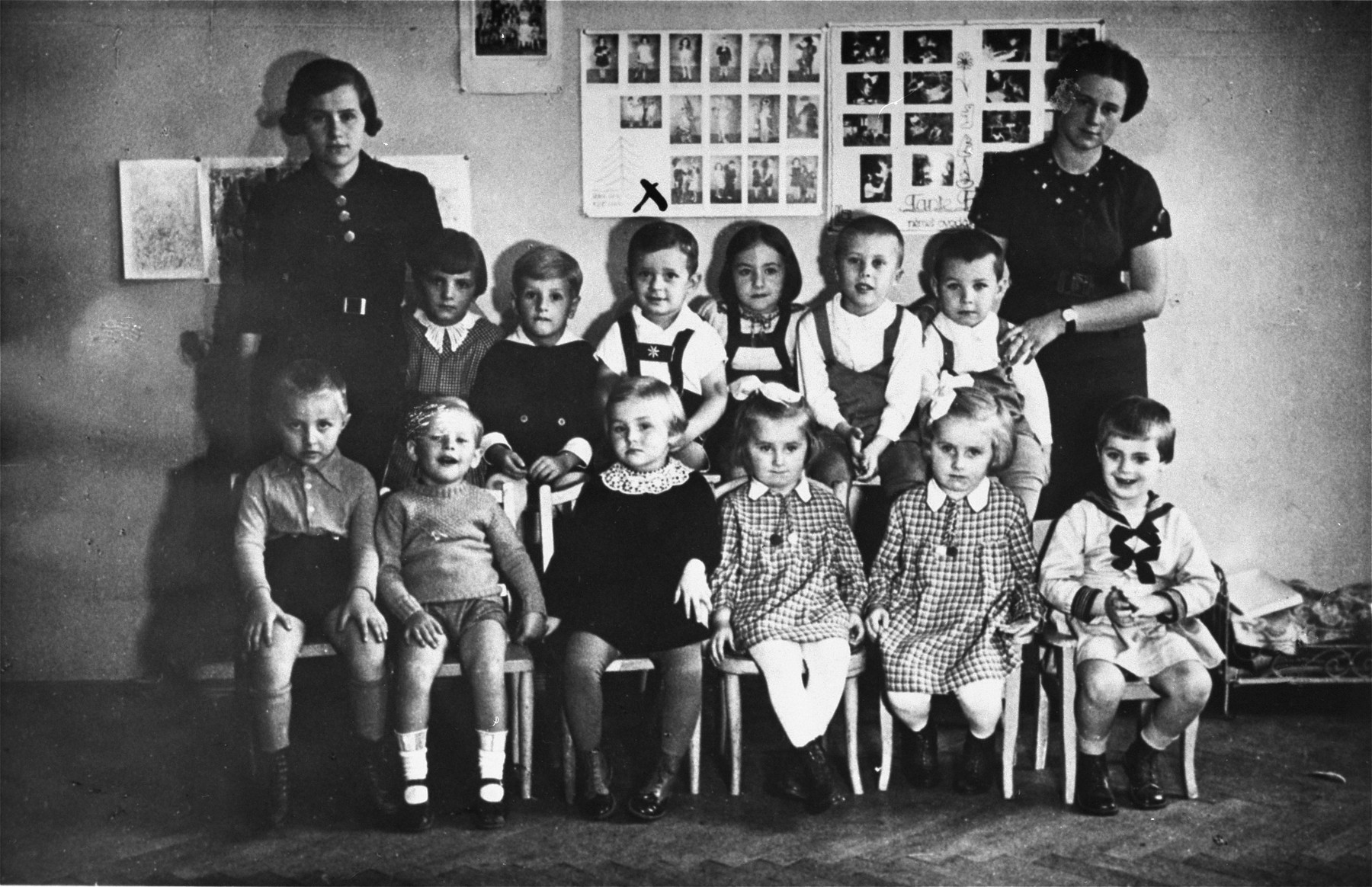 Group portrait of a kindergarten class at a Jewish school in Budapest.  Among those pictured is Otto Friedman, the cousin of Marta Elkana (back row, fourth child from the right).