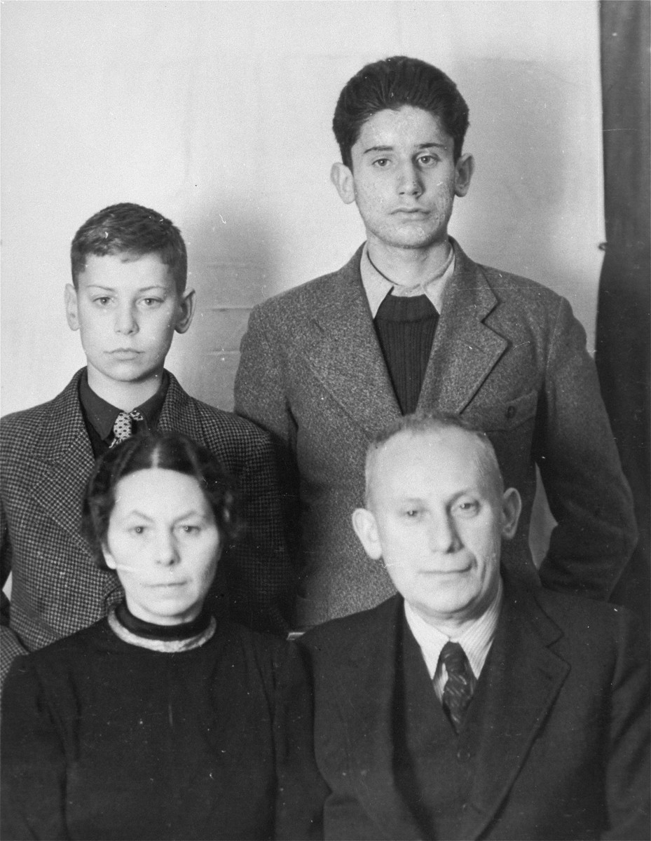 Passport photo of the Weinmann family taken before their departure from Austria in December 1938.  Pictured ar Gustav and Grete Weinmann and their two children, Hanns Robert and Ernst Otto.  The Weinmanns immigrated to America aboard the SS Veendam of the Holland-America Line, which sailed from Rotterdam to New York via Southhampton, England.