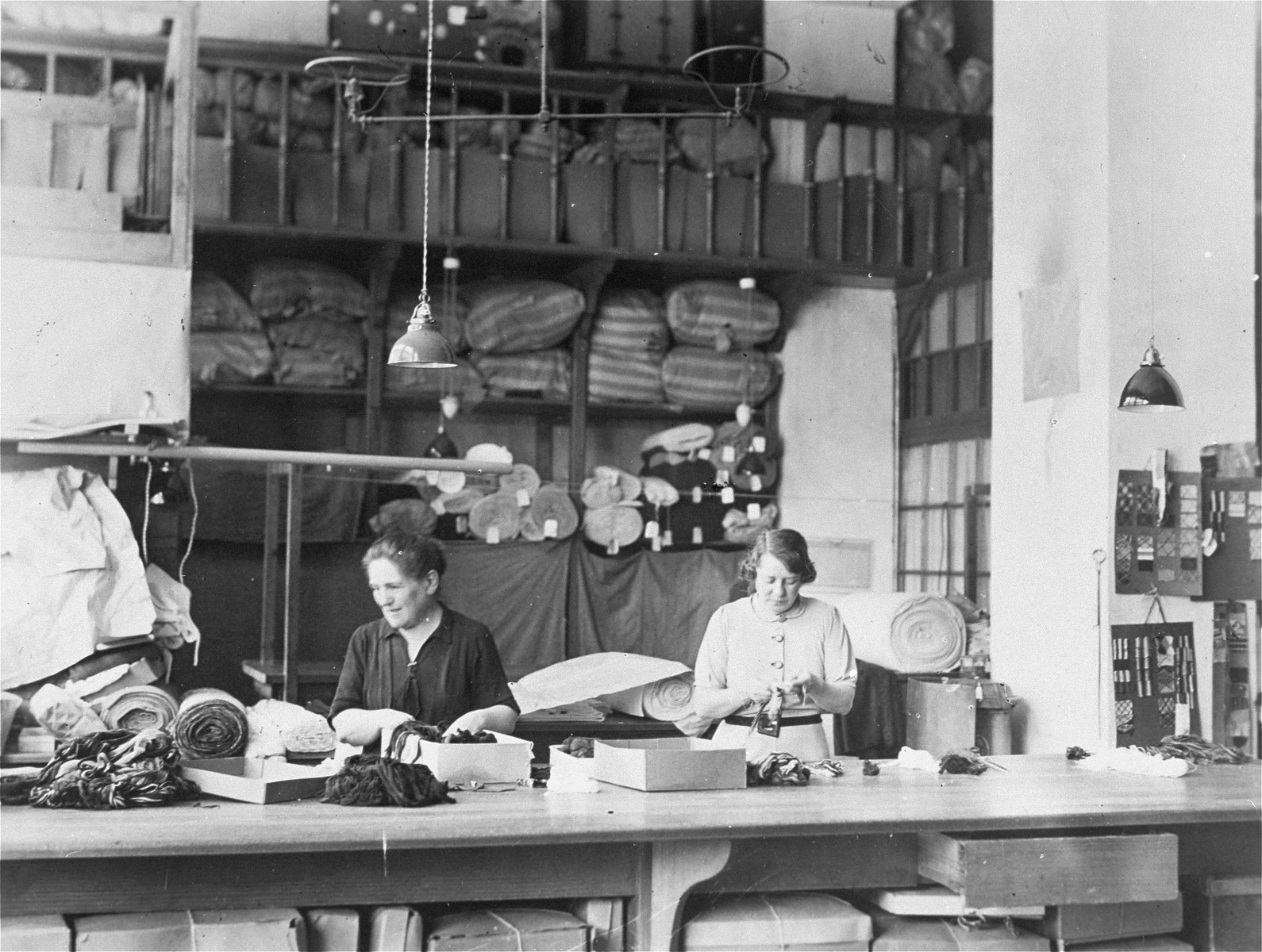 Women at work in a Jewish-owned textile mill in Vienna.   Among those pictured is the owner, Luise Koenigstein, the donor's mother-in-law.