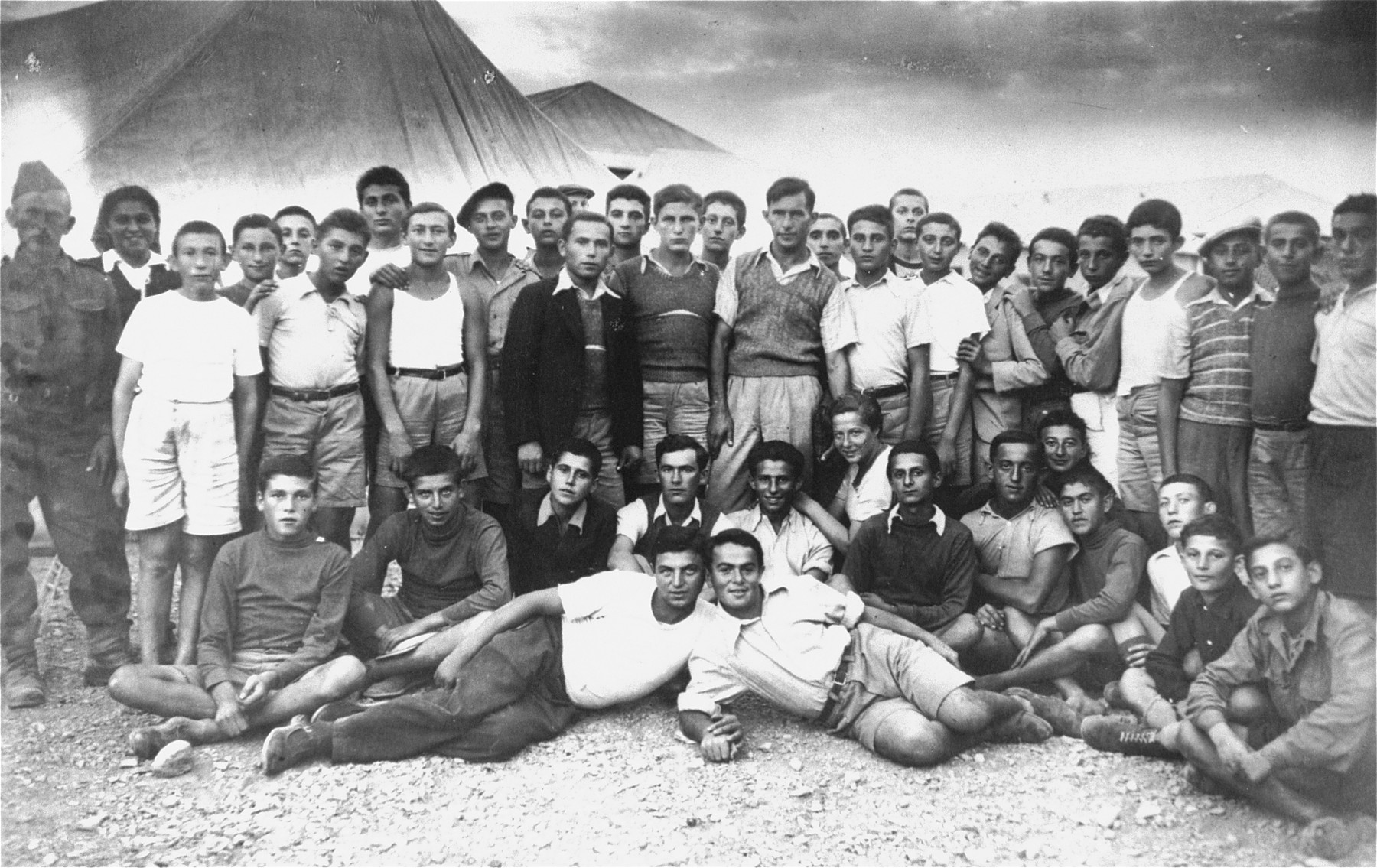 Group portrait of older members of the Teheran children's transport in a refugee camp in Teheran.