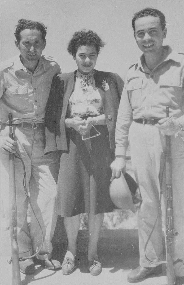 Joshua Heilman with his wife, Hanka Wajcblum Heilman, and Abraham, a friend, during the War of Independence.  Hanka Wajcblum was born in Warsaw in 1928, the youngest of three daughters.  Ester was born in 1927 and her oldest sister, Sabina, married Mieczyslaw Zielinksi and moved to the Soviet Union.  Her parents, Jakub Wajcblum and Rebeka Jaglom Wajcblum, were both Deaf and mute.  After the establishment of the Warsaw ghetto, the father was given permission to produce wooden crosses used at the German military cemeteries.  The family was deported to Majdanek in May 1943.  Jakub and Rebeka perished there.  Ester and Hanka were transferred to Auschwitz Birkenau in September 1943.    They both worked in the Union munitions plant where they were involved in smuggling gun powder and transferring it to Roza Robota.  She in turn transferred it to the Sondercommando underground.  On October 7, 1944 these explosives were used in blowing up the crematorium IV in Birkenau.  Four young women were arrested and tortured.  On January 5, 1945, Ester Wajcblum along with Roza Robota, , Ala Gertner and Regina Safirsztajn were publicly hanged in Auschwitz.     Hanka was transferred to Neustadt Gloeve where she was liberated in May 1945 at the age of sixteen.  She later moved to Ein-Yiron, Israel and married Joshua Heilman in March 1947.