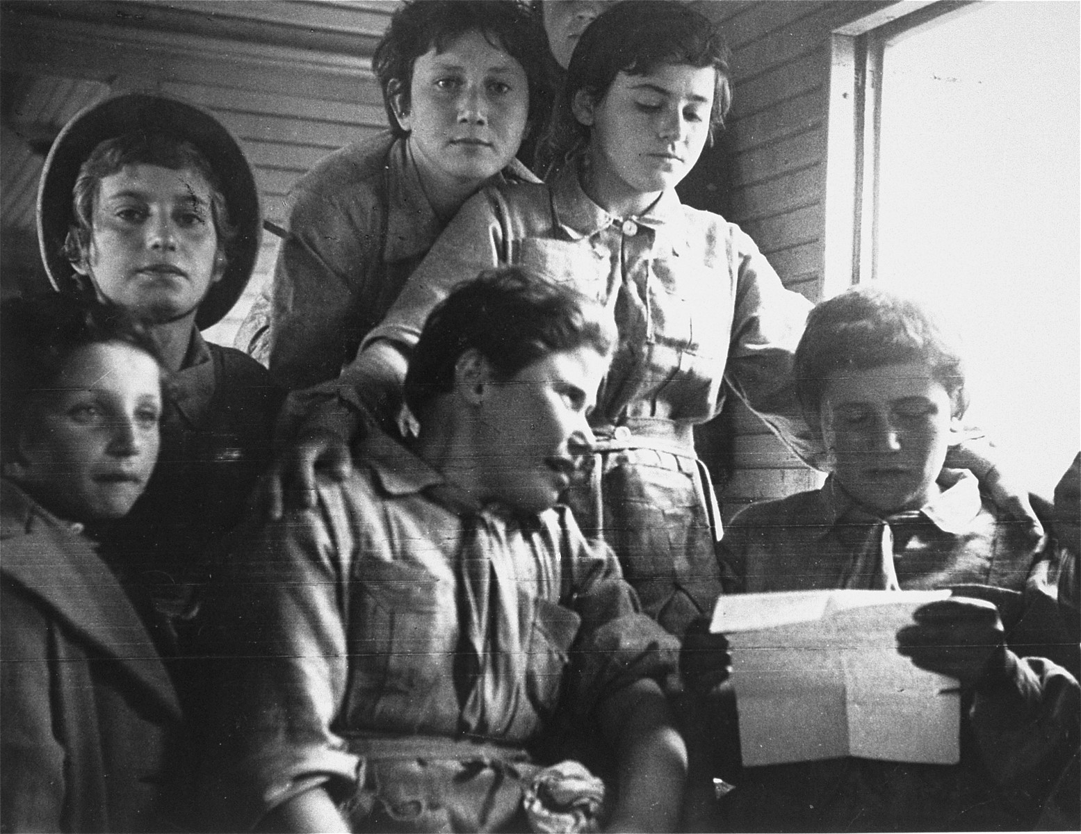 A group of Jewish refugees on the Teheran children's transport travel by train to Palestine.