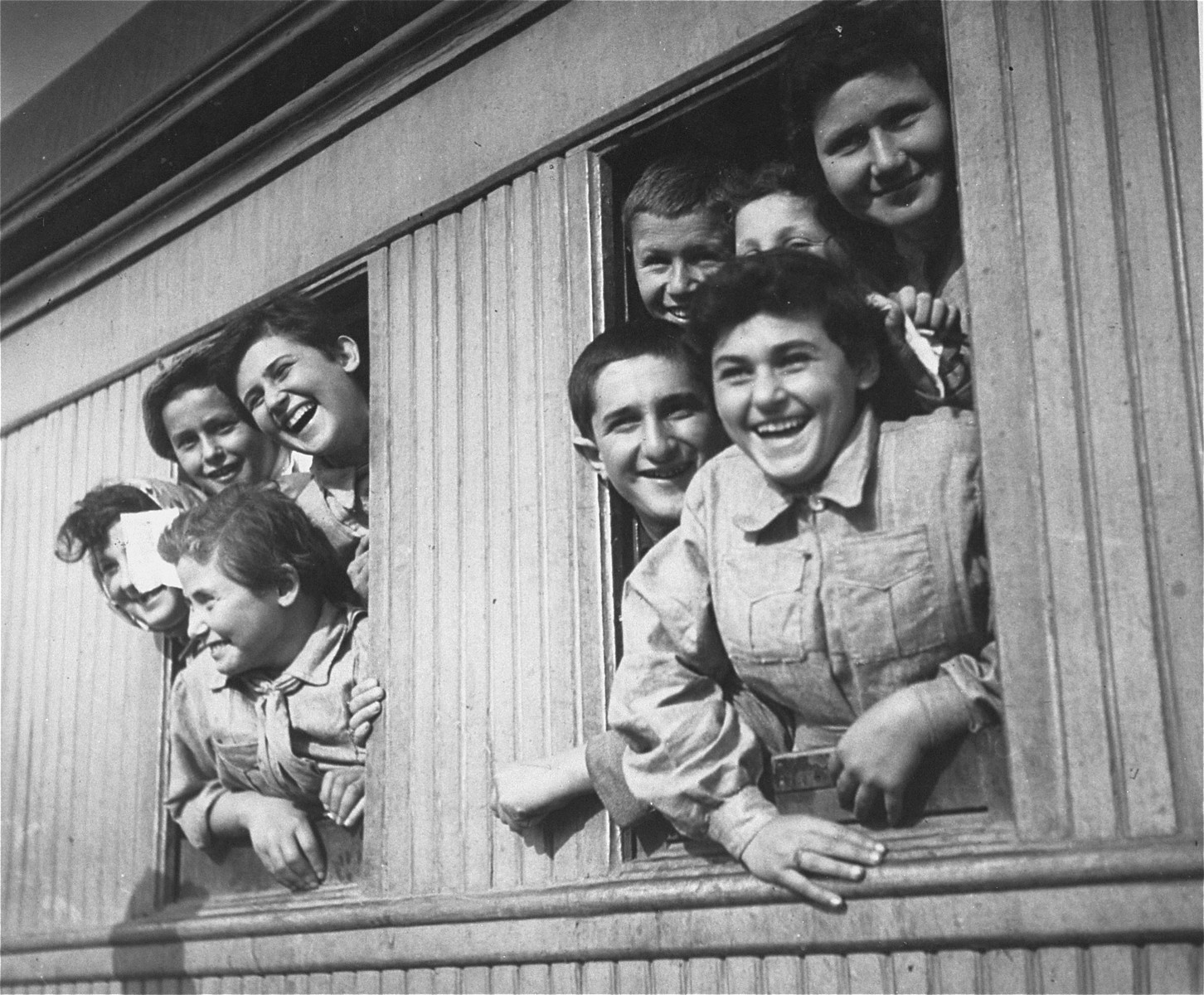Members of the Teheran children's transport look out the windows of their train as it pulls into the station in Athlit.