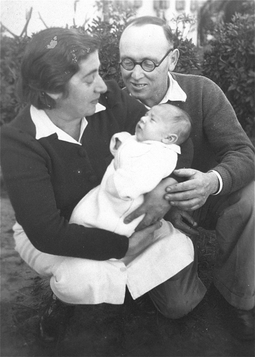 Portrait of a young refugee couple with their newborn.  Pictured are the donor's uncle, aunt, and cousin, Majer, Devora, and Moshe Gar at kibbutz Givat Hashelosha near Petah Tikva.