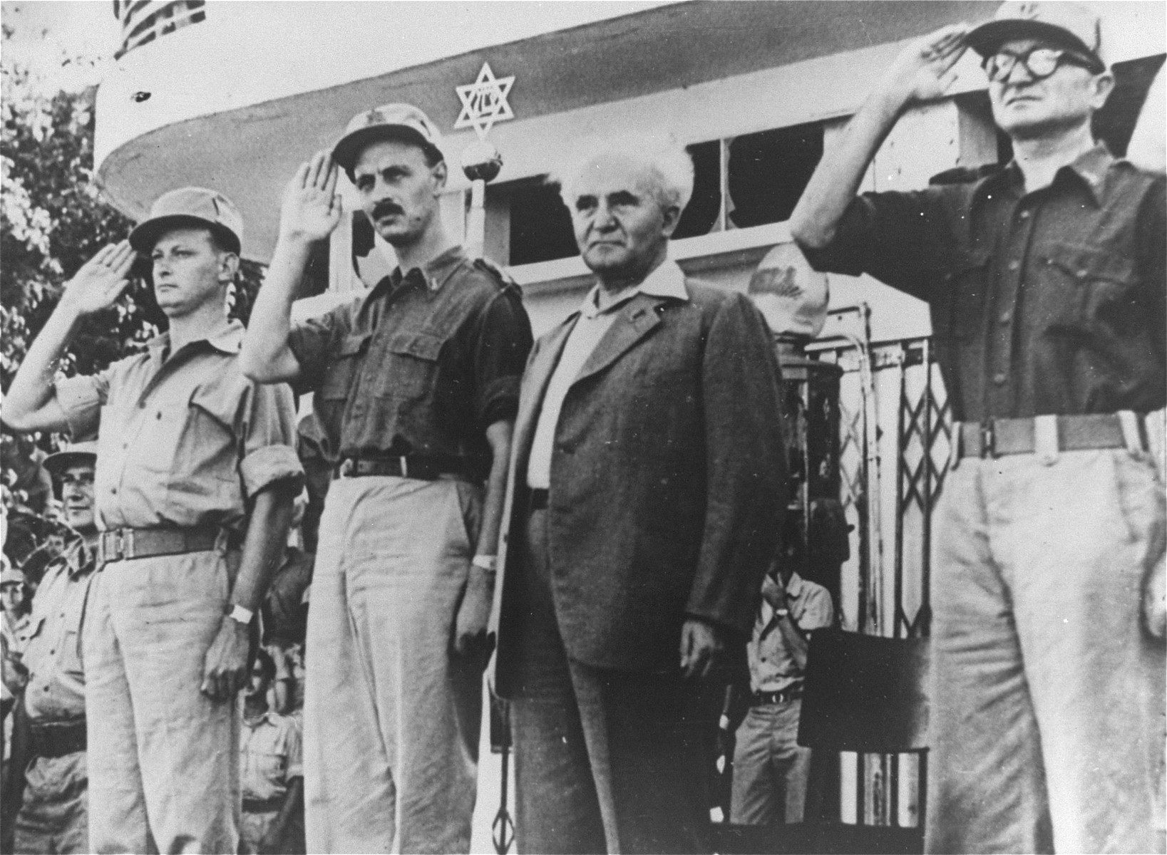David Ben-Gurion, the Prime Minister of Israel, inspects troops in Tel Aviv along with General Yigal Allon (far left) and General Yigal Yadin (second from the left).