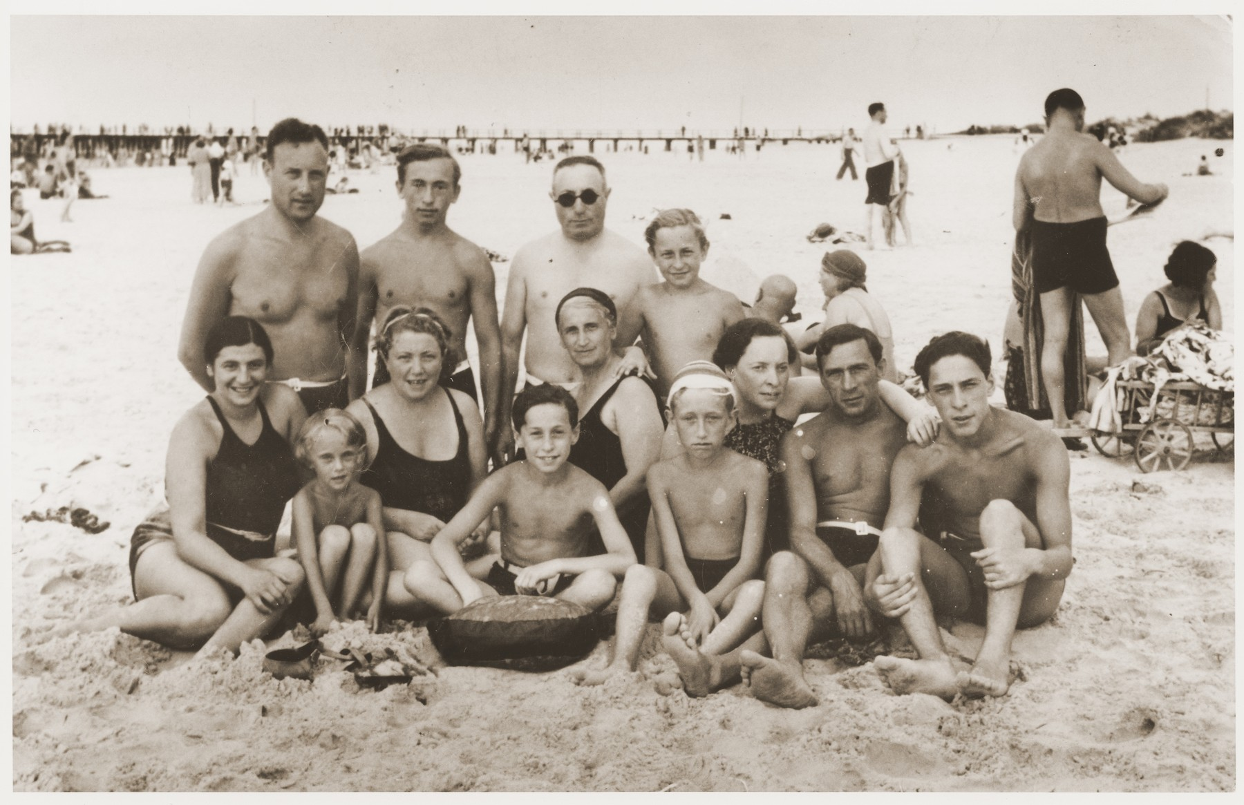 A Lithuanian-Jewish family poses for a vacation at the beach in Palaugin.    Pictured first row (left to right) Bella Adler (survived) and Fruma Vitkin (taken out of ghetto and hidden).  Back row: Fruma Vitkin's parents (perished), Pinchos Birger and his son (Zev).