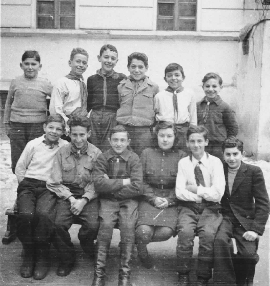 Marcel Koller attends a young pioneers school in Cernauti after his family's return from Transnistria.  Marcel Koller is pictured standing in the center (third from the left) in a dark shirt.