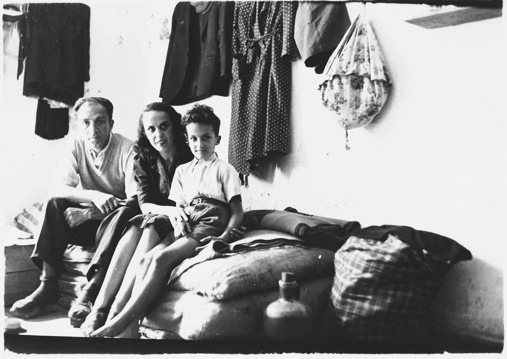 A Jewish family living in a prison cell in Italian-occupied Pristina.  Pictured are Majer and Mimi Altarac with their son Jasa.