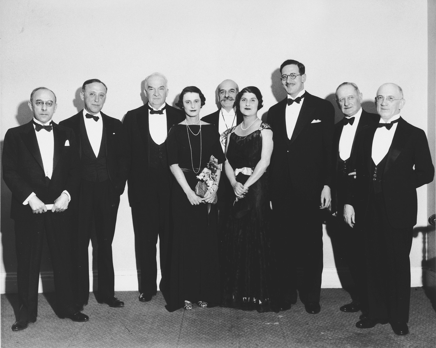Leaders of the Greater New York campaign of the United Jewish Appeal gather to raise $1,250,000 for the settlement of Jews from Germany and other lands in Palestine.  Left to right: Edwin Goldwasser, co-chairman of the Greater New York campaign, Rabbi Jonah B. Wise, George Gordon Battle, Mrs. Richard Percy Limburg, Felix Warburg, Mrs. Richard Strauss, William Rosenwald, Paul Baerwald and Michael Schaap.