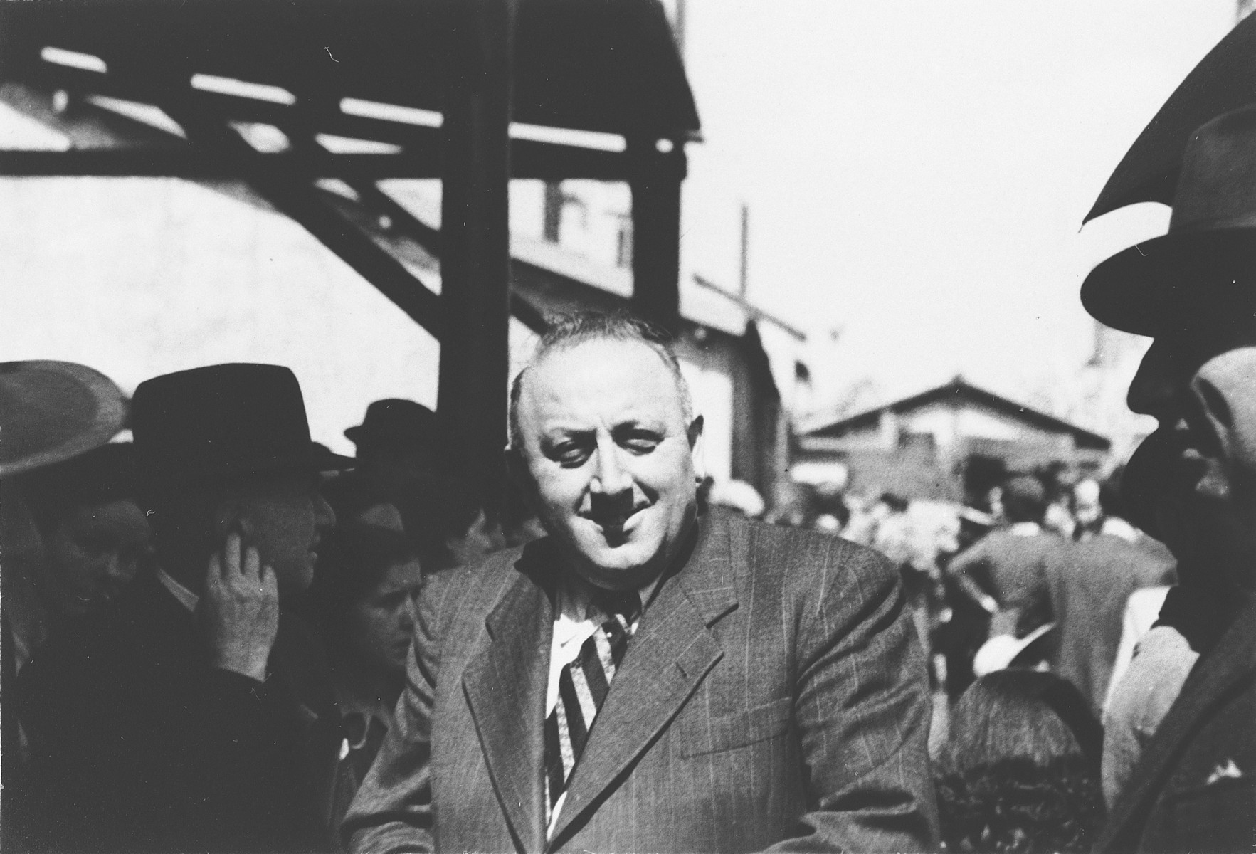Albert Nussbaum, Director of Transmigration for the American Joint Distribution Committee, poses in the port of Lisbon where Jewish refugees wait to board the SS Mouzinho.