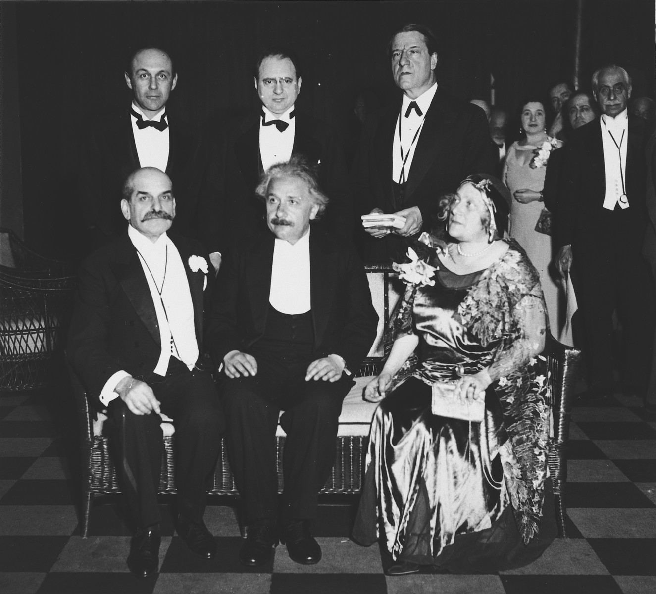 Group photograph of American Jewish leaders and recent German Jewish emigres to the United States.  Those pictured include Felix Warburg (seated, far left), Albert Einstein (seated center), Elsa Einstein (seated, right), Morris Rothenberg (standing, center) and Rabbi Stephen Wise (standing, far right).