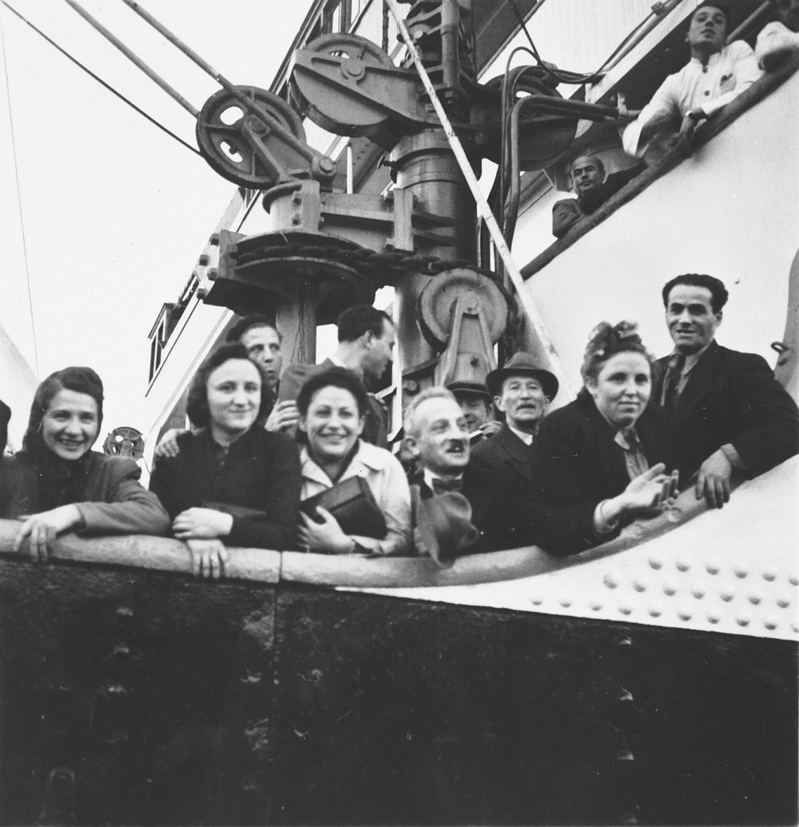 Jewish refugees look out from the deck of the SS Serpa Pinto before its departure from the port of Lisbon.