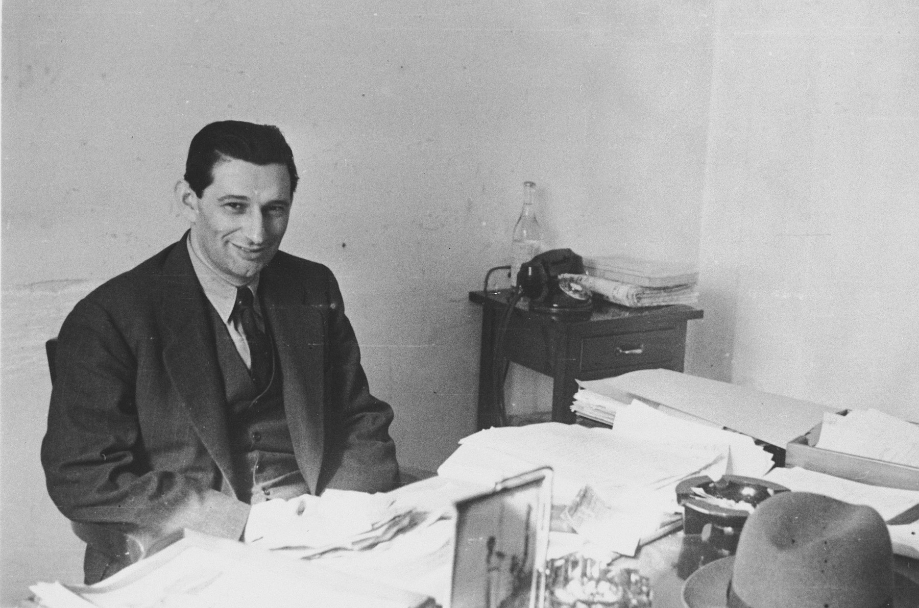 Joseph Schwartz, European director of the American Joint Distribution committee, at work in his office in Lisbon.