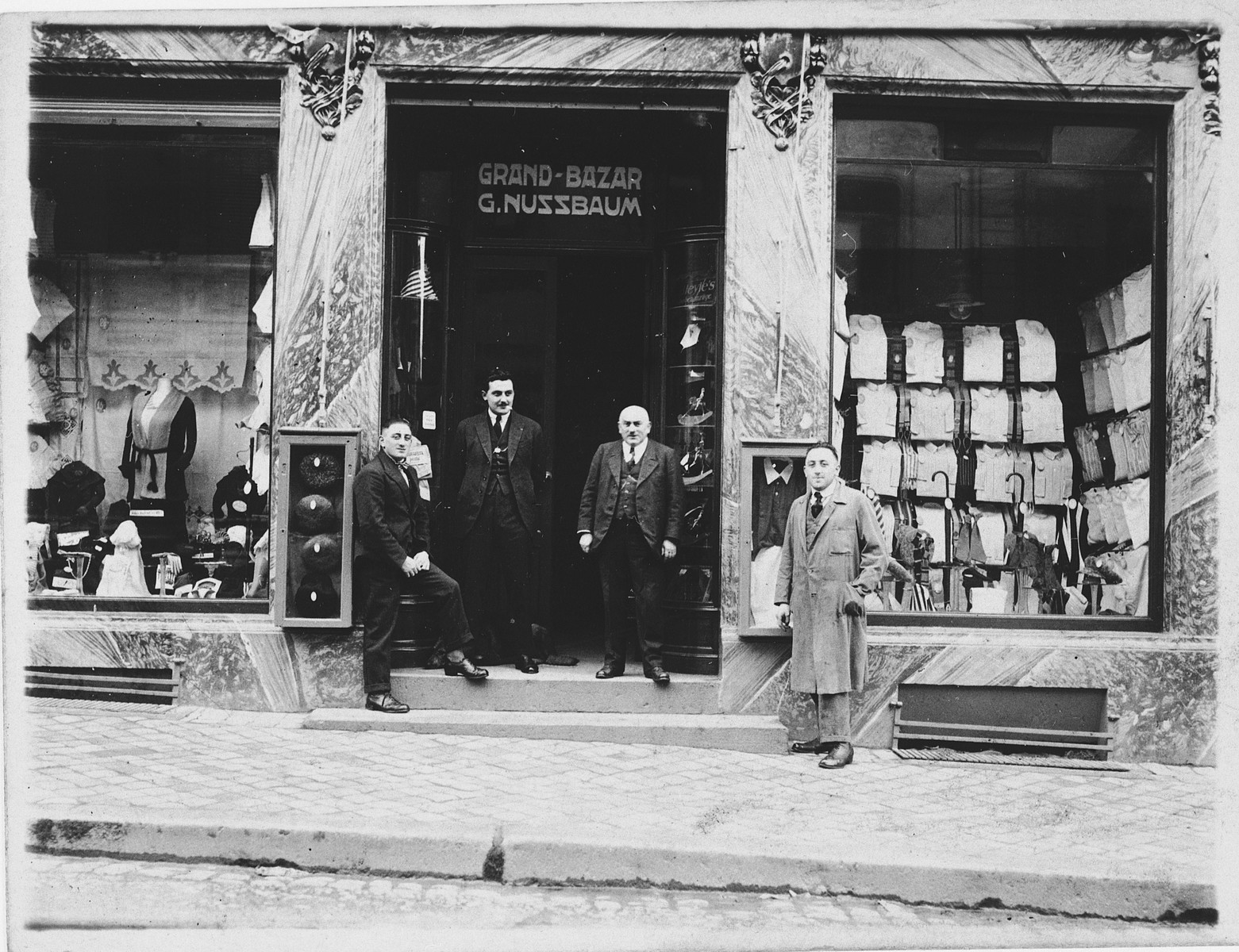 Gustave Nussbaum poses with others in front of his clothing store, Grand-Bazar G. Nussbaum, in Luxembourg.