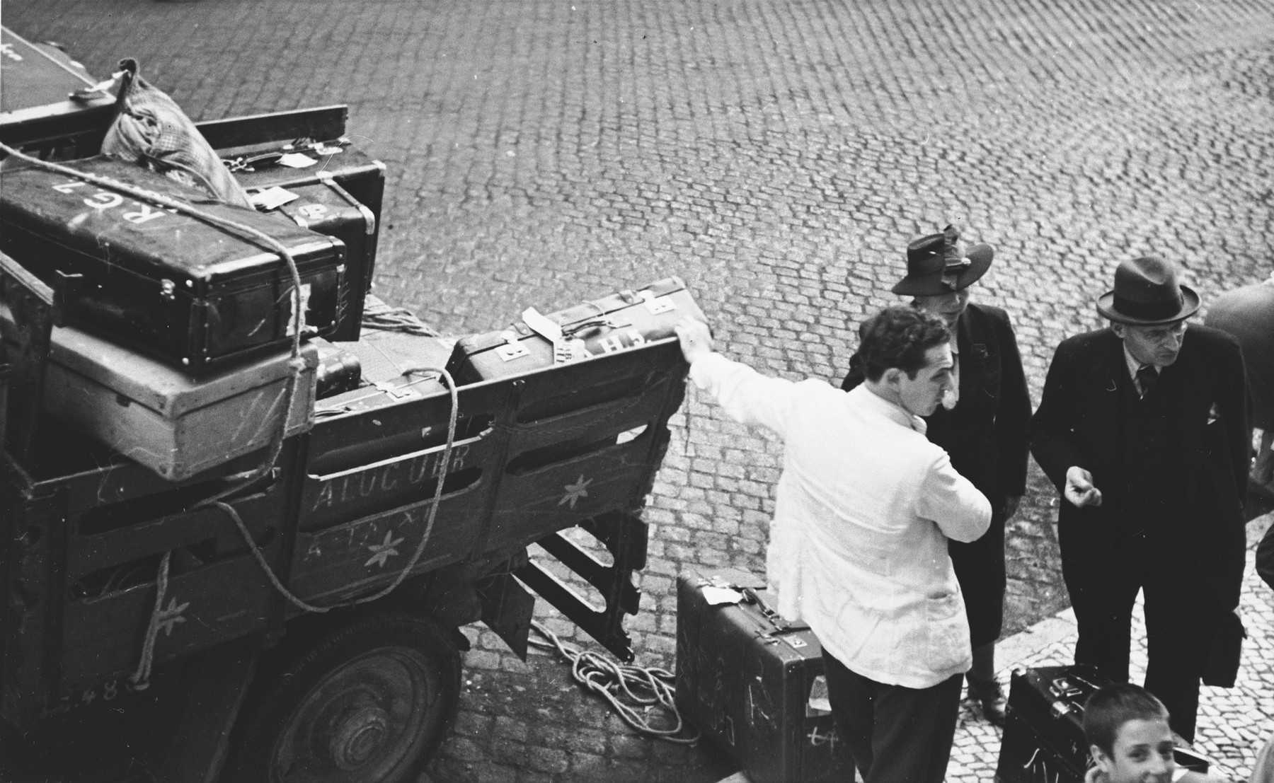 The suitcases of newly arrived Jewish refugees are loaded onto the back of a truck in Lisbon.