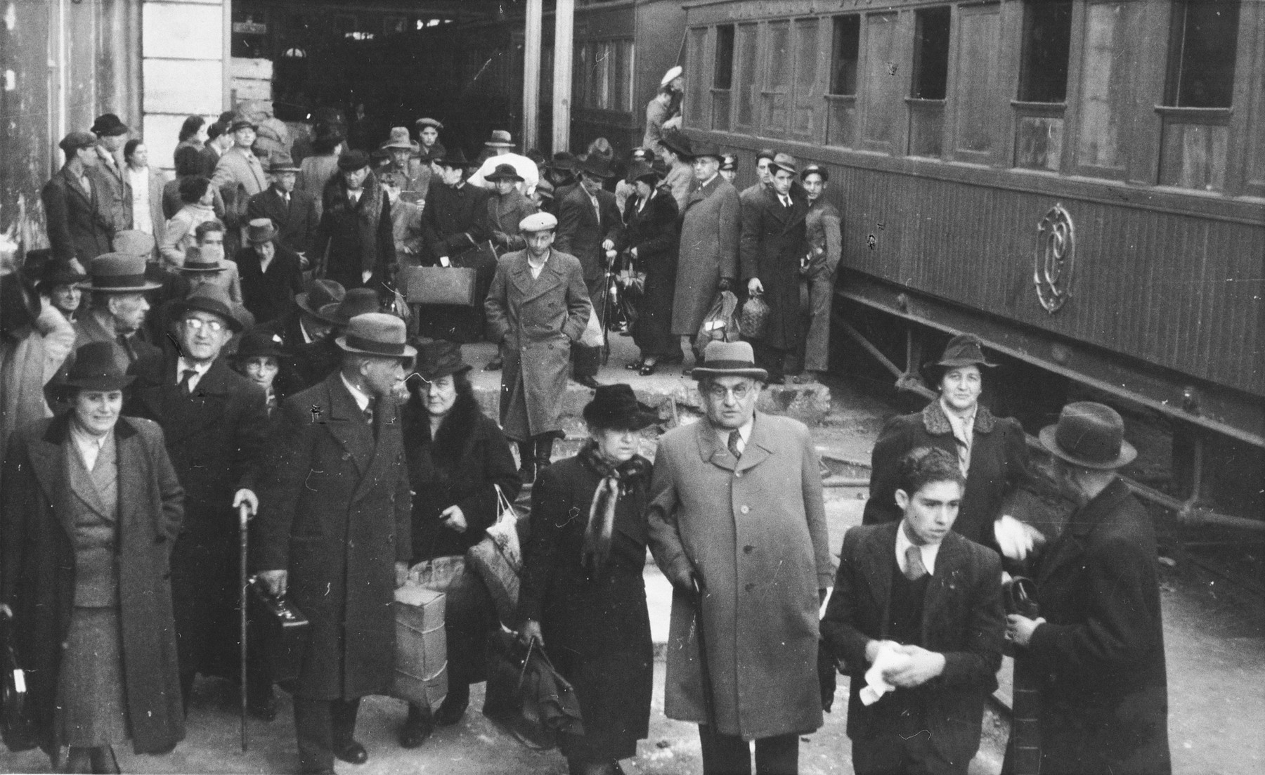 Group portrait of newly arrived Jewish refugees at the St. Appolonia train station in Lisbon.