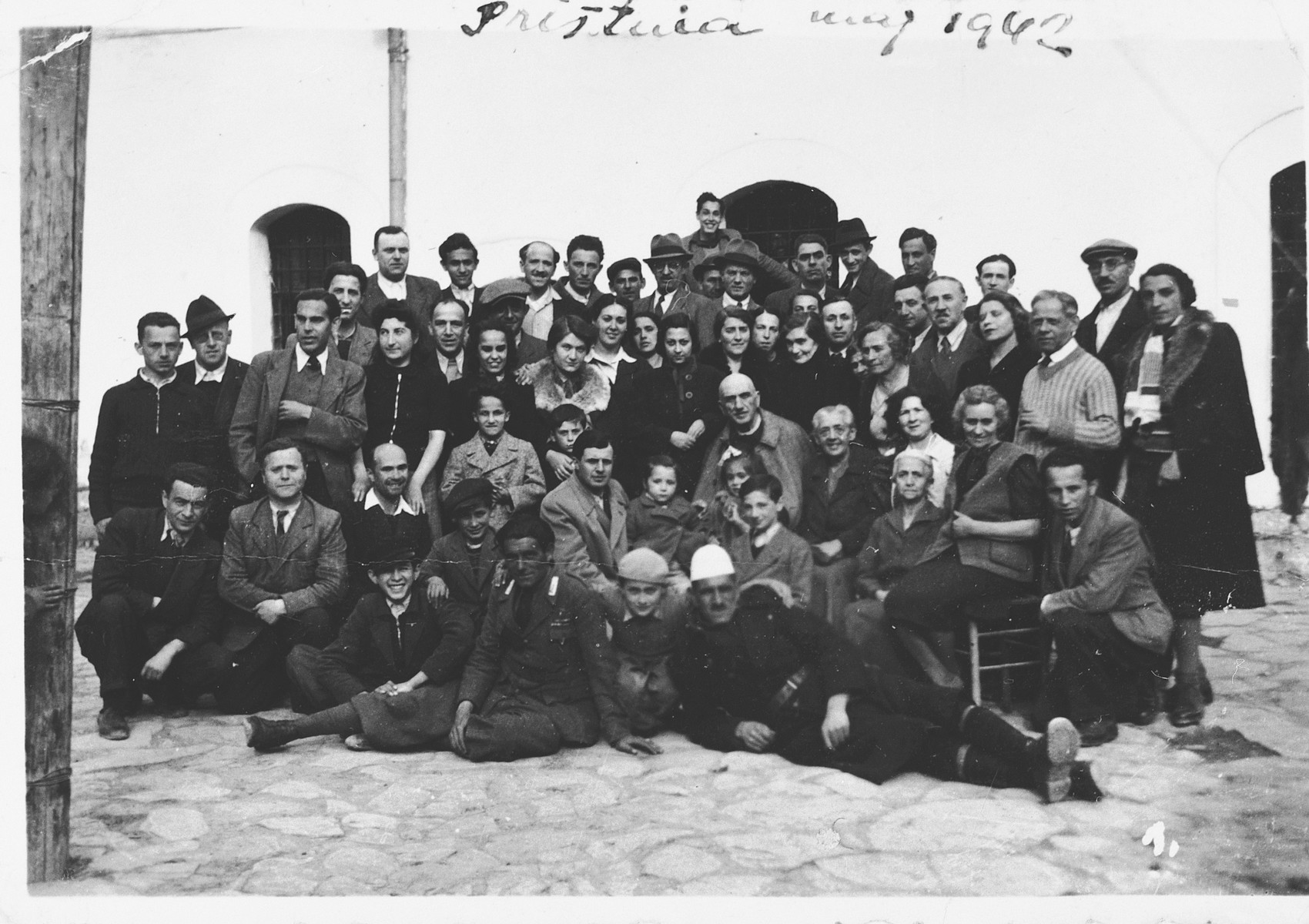Group portrait of Yugoslavian Jewish refugees who are living in a prison in Italian-occupied Pristina.