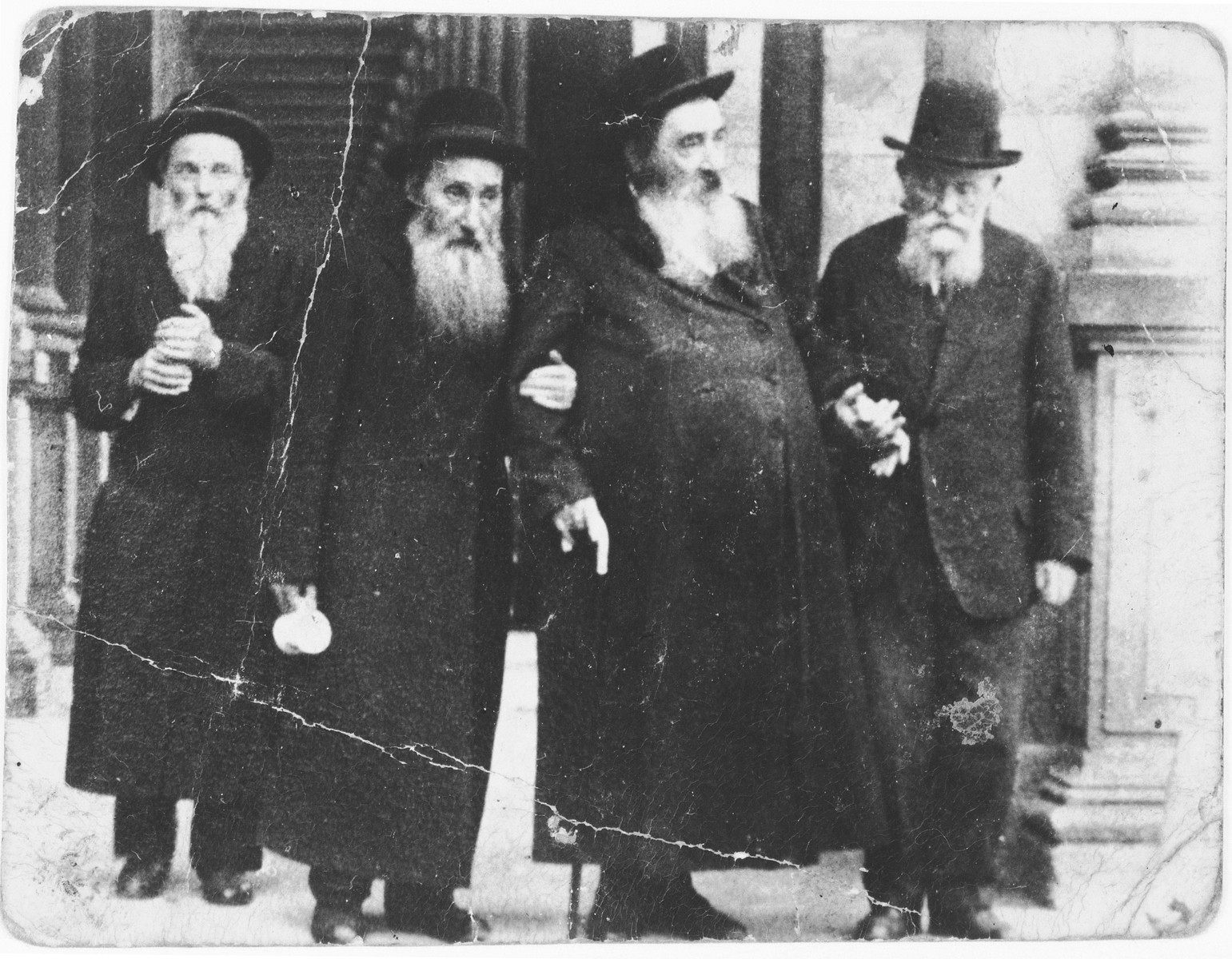 The Vizhnitser Rebbe, Rabbi Israel Hager, poses with three of his followers.