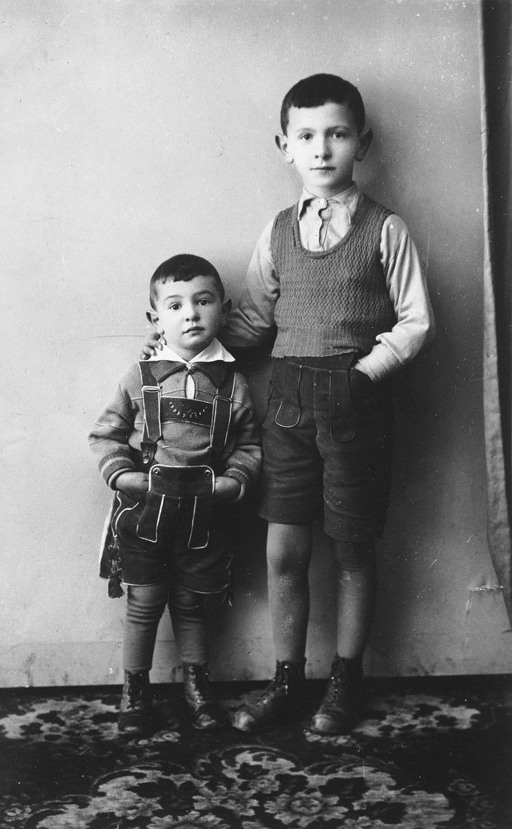 Studio portait of two Jewish children.  Pictured are Marcel (left) and his older brother, Dov Koller (right), taken in Vienna while on a visit to their mother's family.