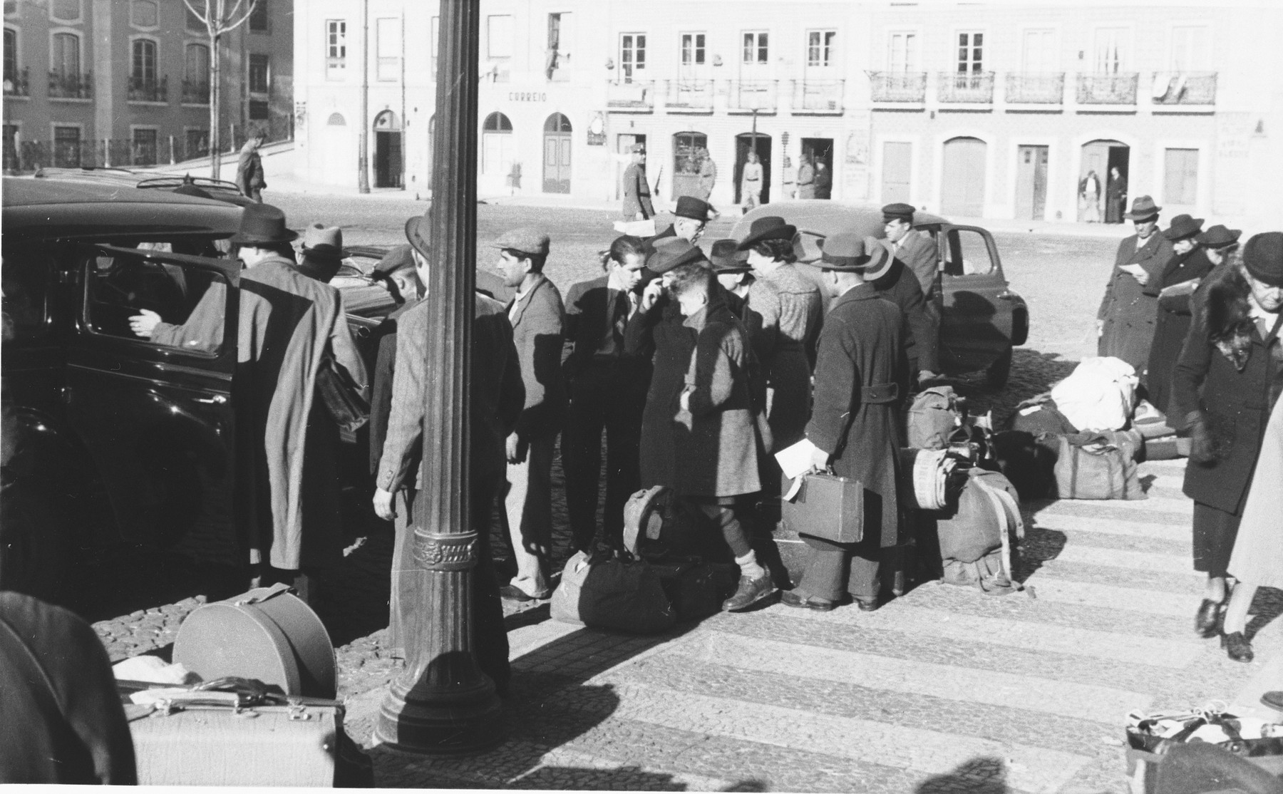 A group of Jewish refugees who have just arrived in Lisbon, get into an automobile, in front of the St. Appolonia train station.