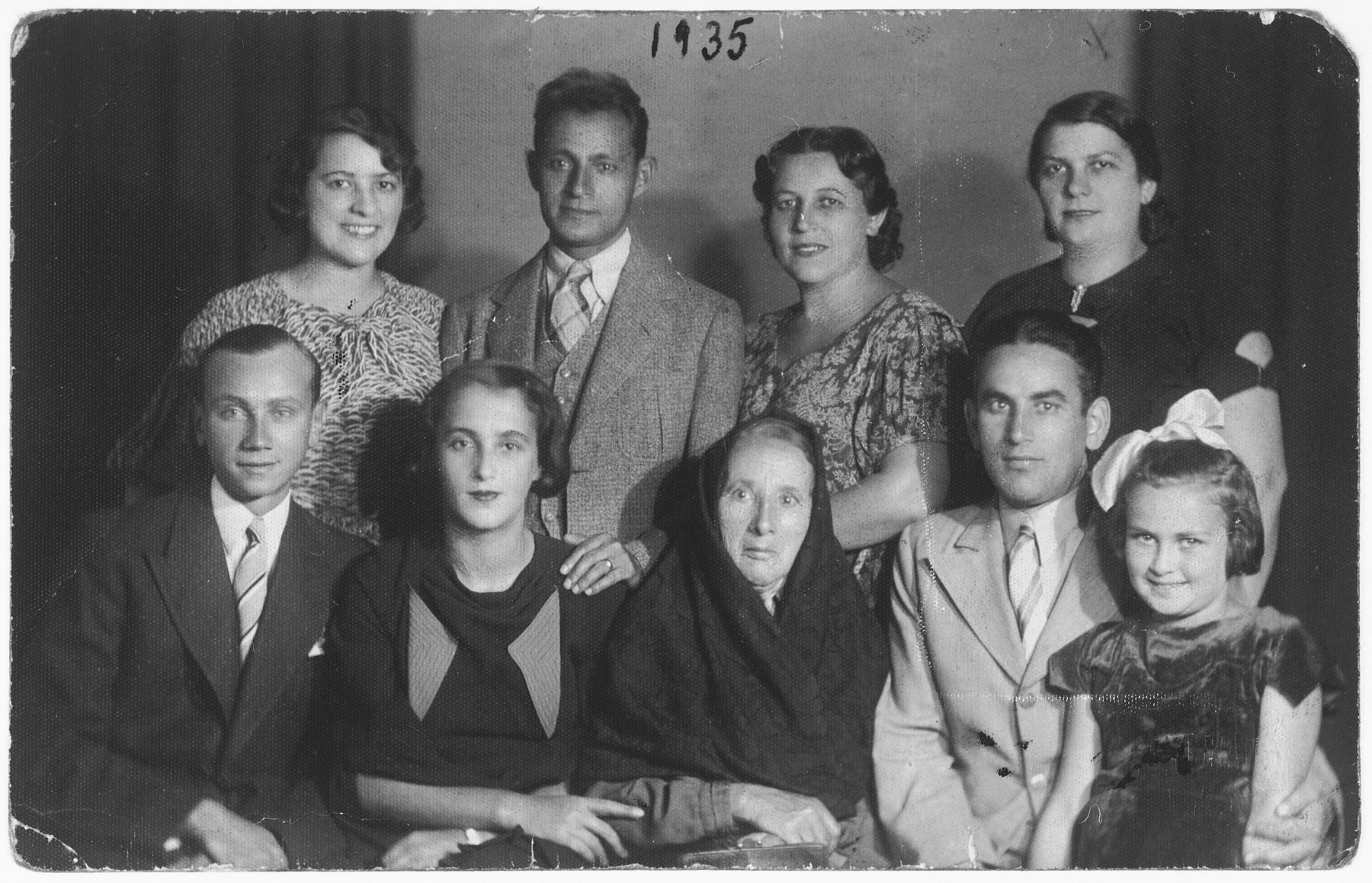 Group portrait of members of the Kwar family with friends visiting from America.
