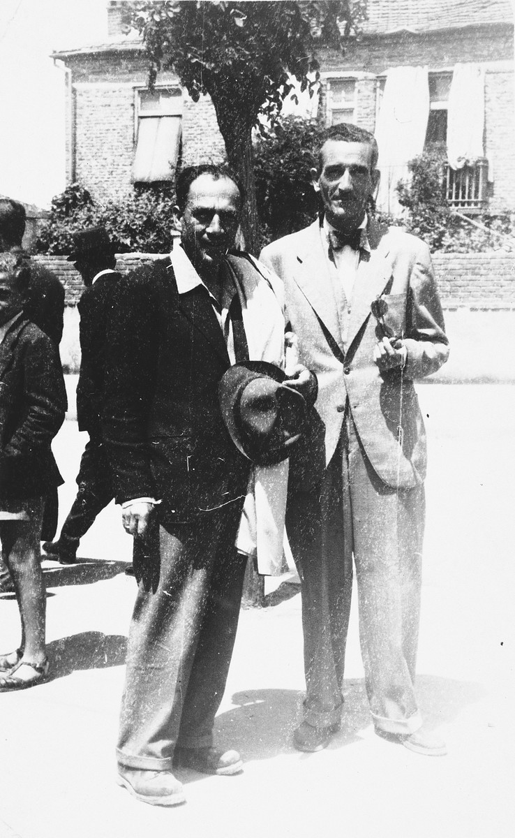 Majer Altarac, (left), a Jewish refugee from Belgrade, poses outside with David Amarilio, a Macedonian Jew who has given him and his family lodging in Bulgarian-occupied Skopje.
