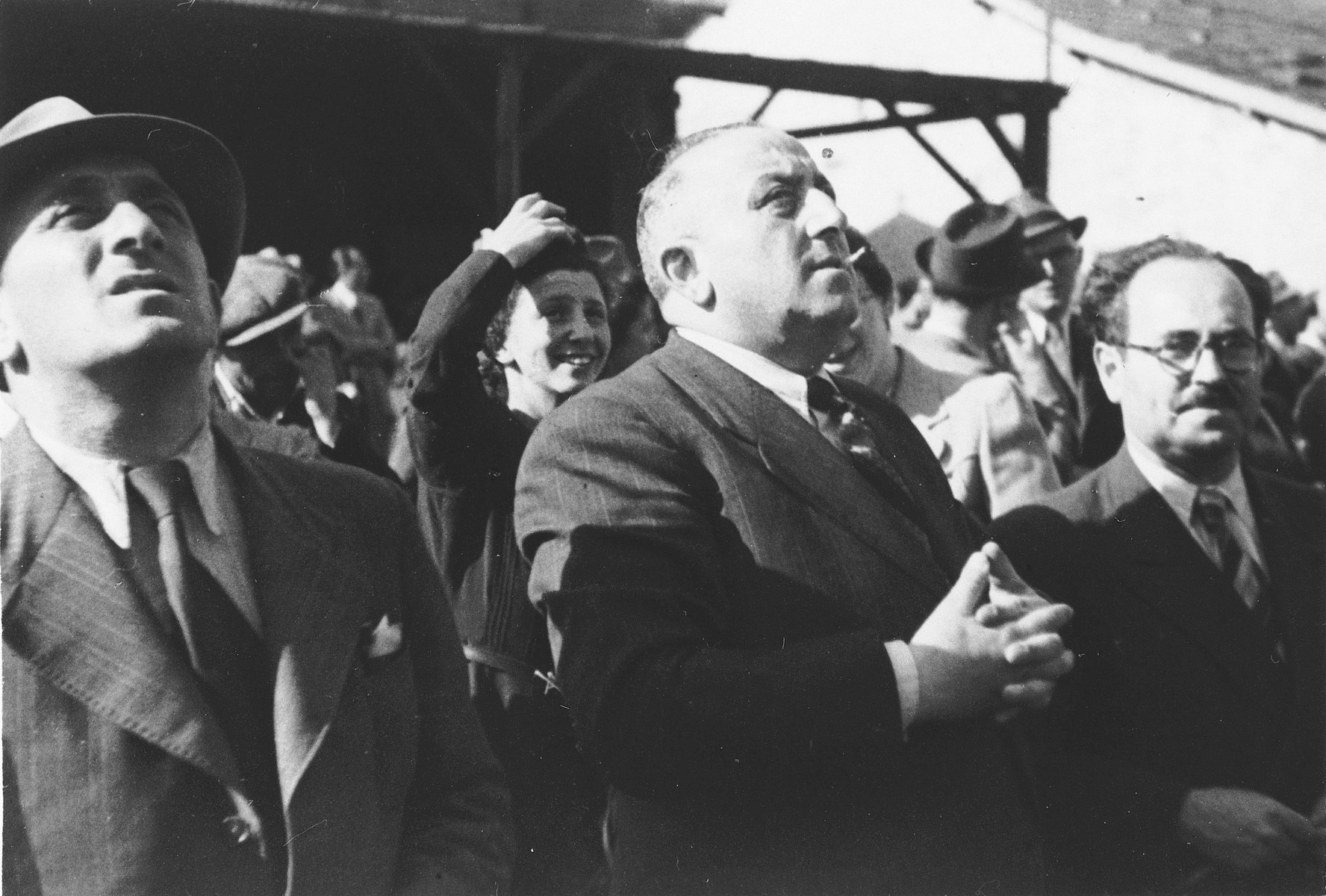 Albert Nussbaum, Director of Transmigration for the American Joint Distribution Committee, watches from the pier in the port of Lisbon the departure of Jewish refugees aboard the SS Mouzinho.