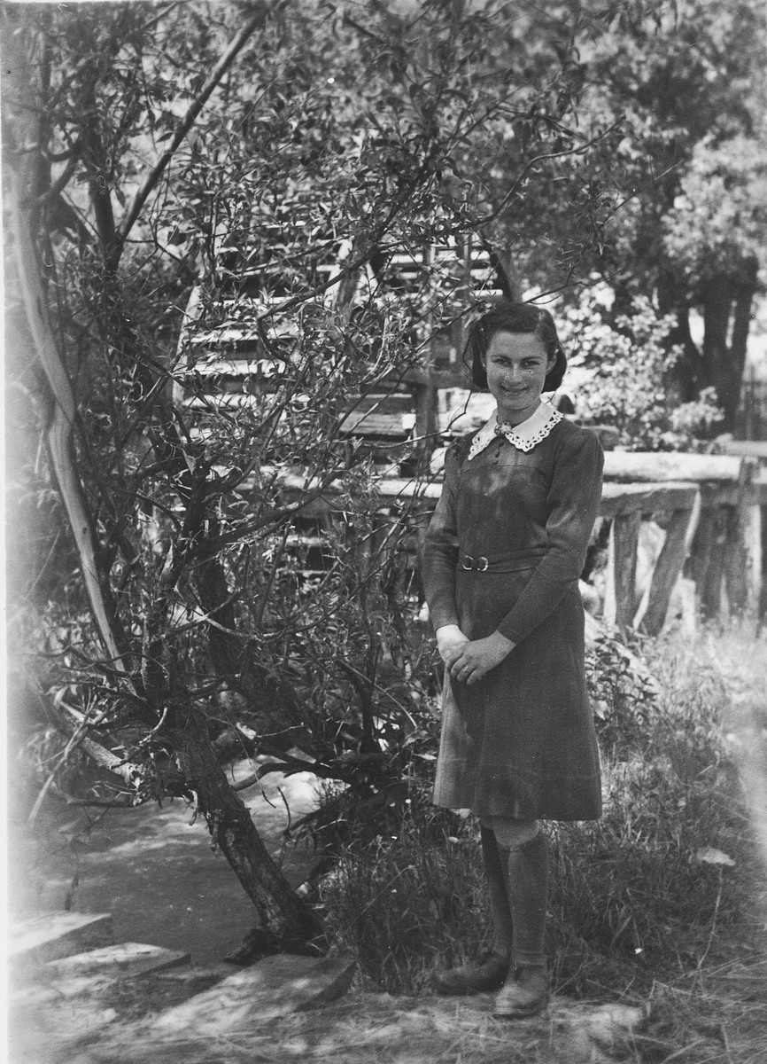 Rosa Kwar poses in a garden while in hiding in Sieciechowice.