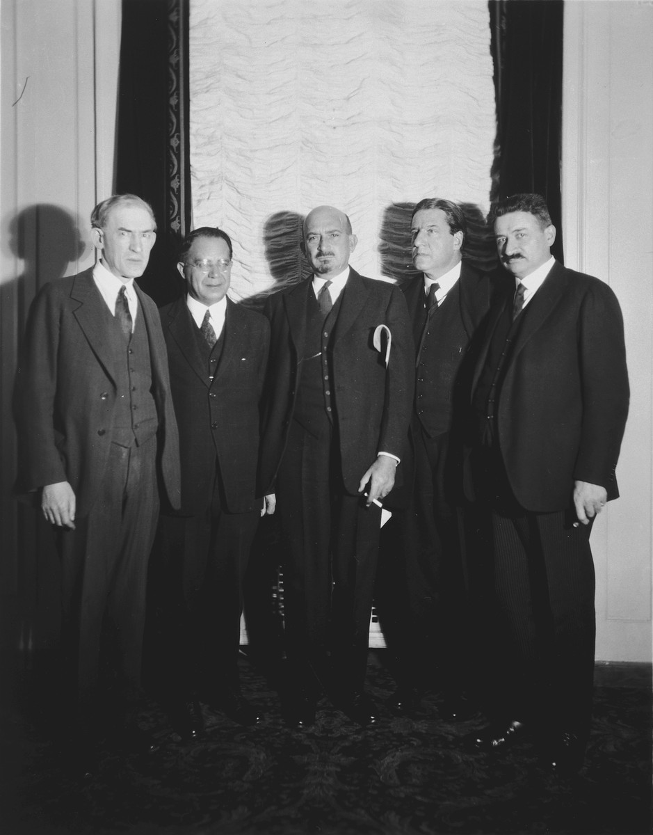 Portrait of American Zionist leaders posing with Dr. Chaim Weizmann.  From left to right are Louis Lipsky, President Zionist Organization of America; Judge William M. Lewis, Chairman United Palestine Appeal; Dr. Chaim Weizmann, President World Zionist Organization; Rabbi Stephen S. Wise, and Dr. George Halpern, Zionist economic expert.