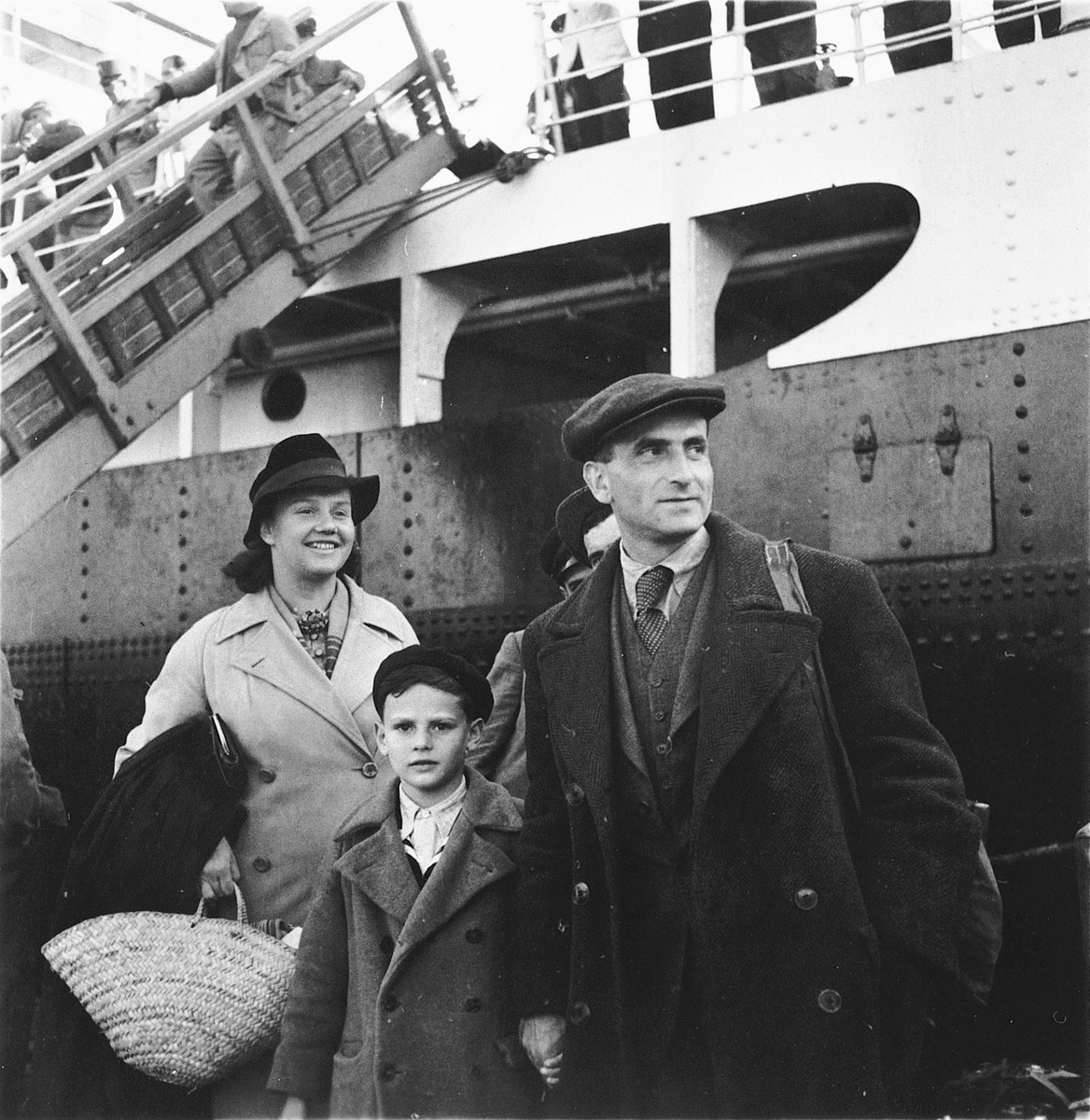 A Jewish refugee family prepares to board the SS Serpa Pinto in the port of Lisbon.