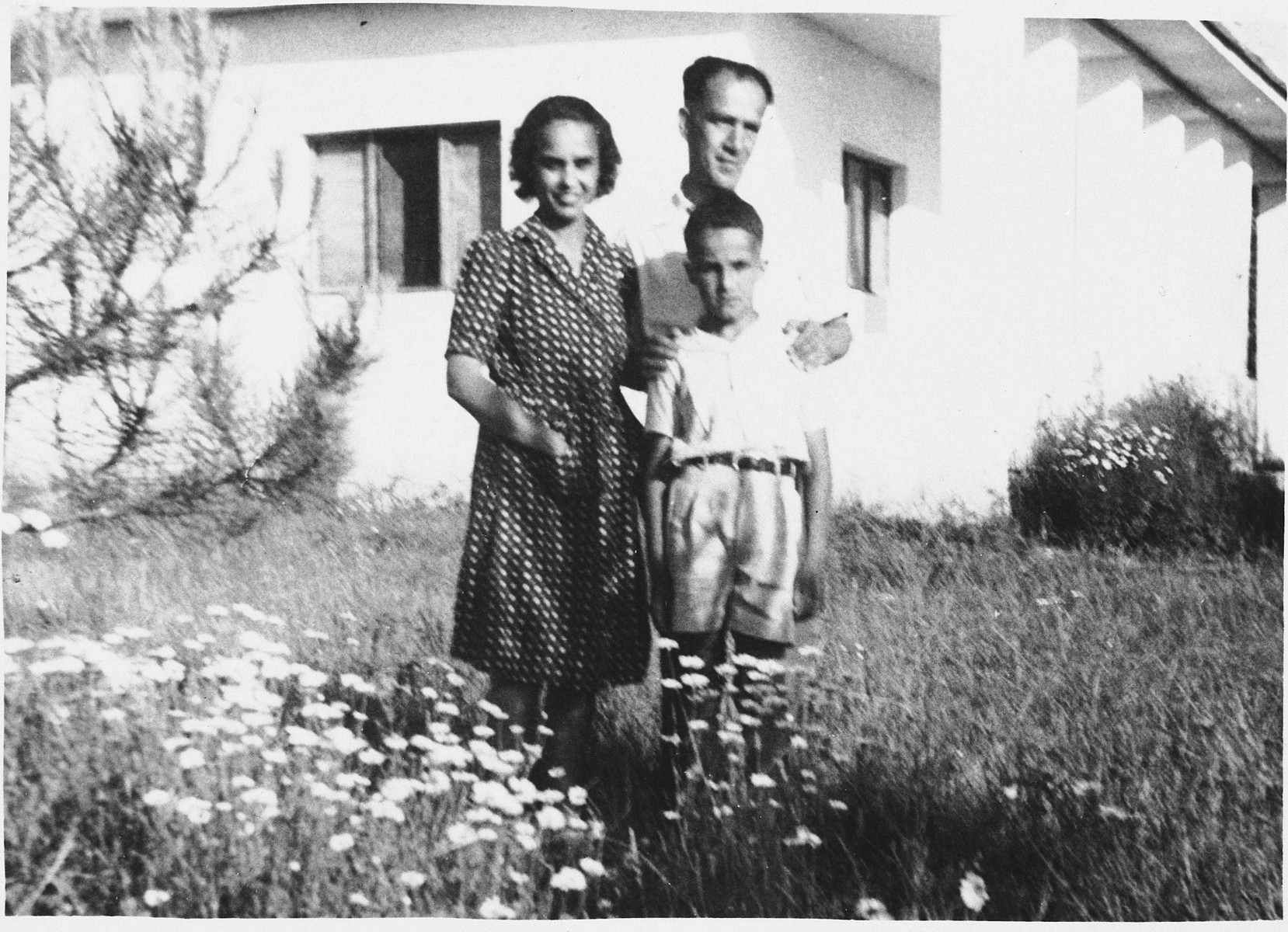 Portrait of a Yugoslavian Jewish family living in hiding in Kamza, Albania on the estate of Atif and Ganimet Toptani.  Pictured are Majer and Mimi Altarac with their son Jasa.
