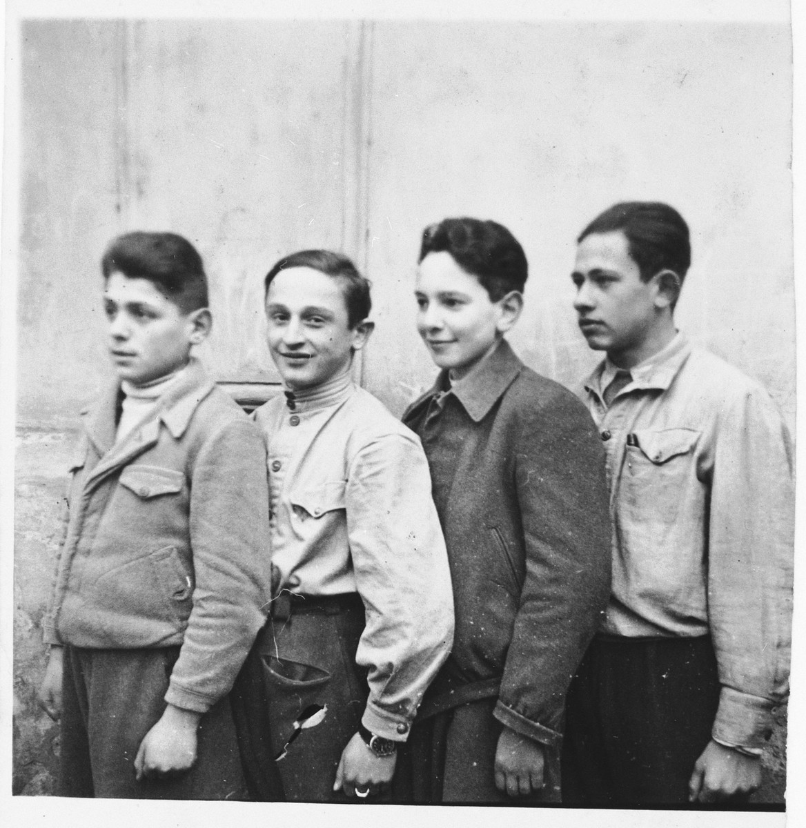 Marcel Koller poses with three friends from a young pioneers school in Cernauti after his family's return from Transnistria.  Marcel Koller is standing second from the right in a dark jacket.