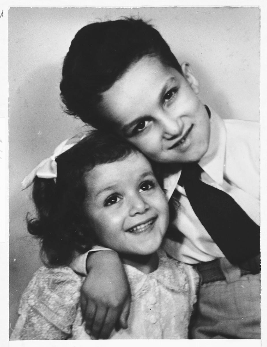 Studio portrait of two Jewish children in Belgrade, Serbia.  Pictured are Jasa Altarac and his sister, Lela.