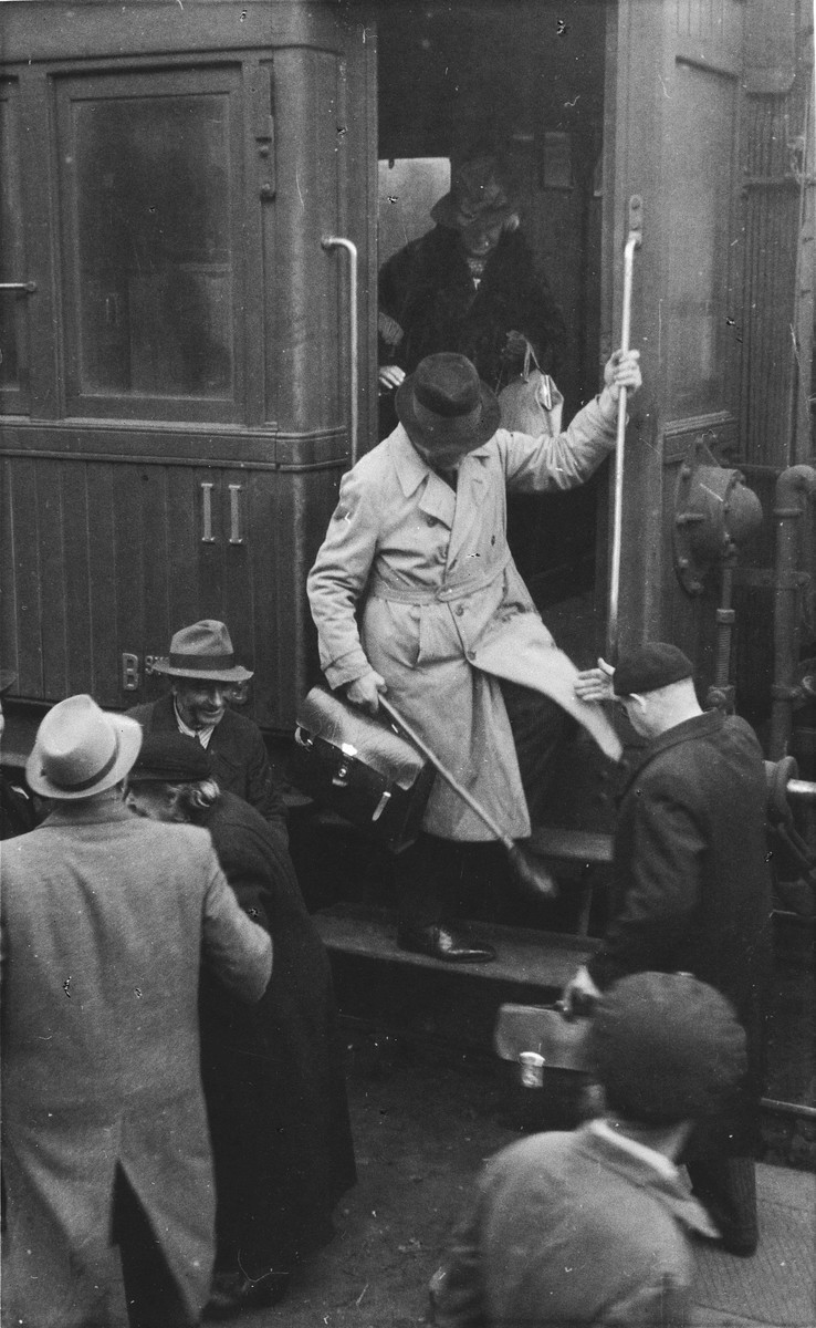 A group of Jewish refugees arrives by train in Lisbon.