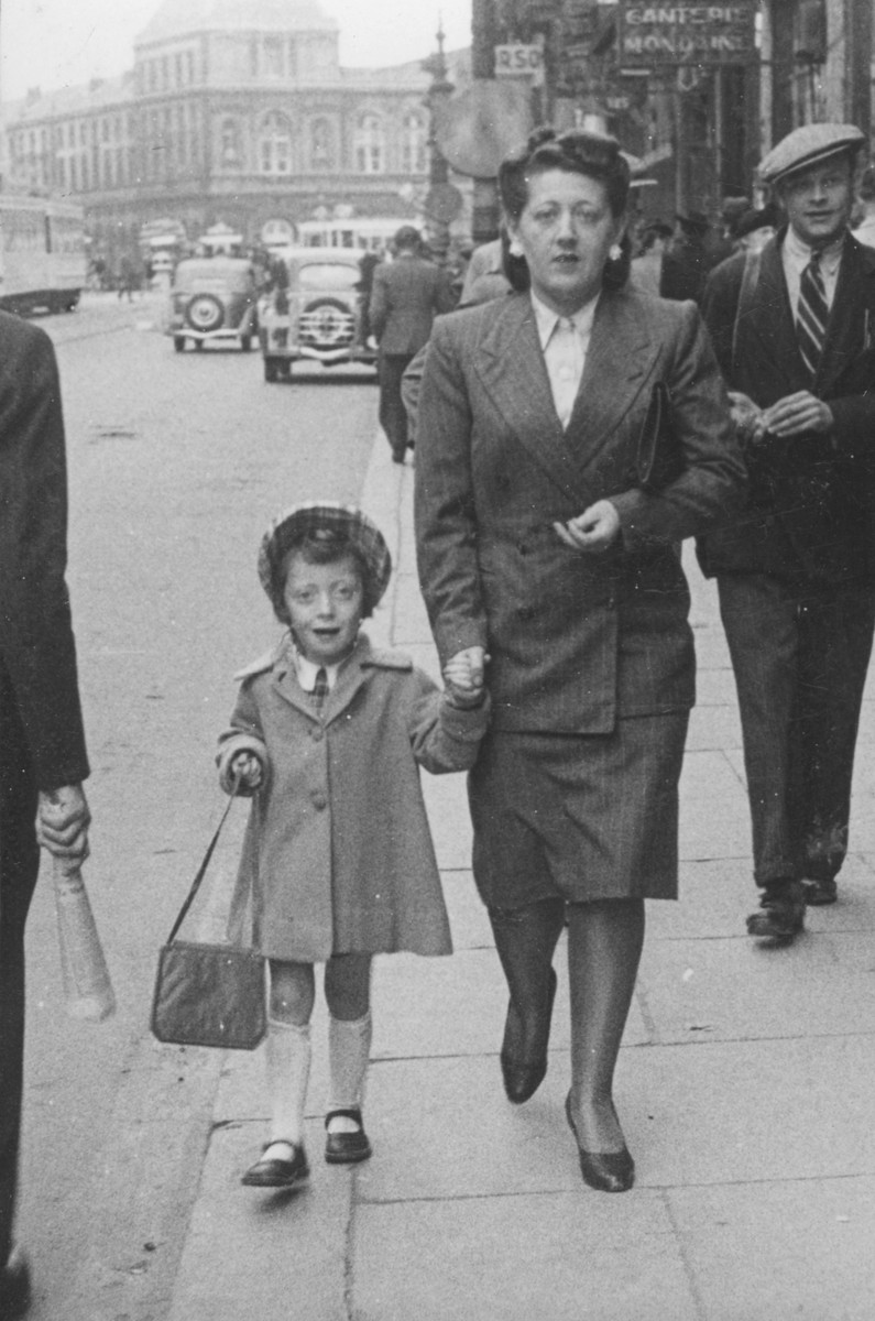 Austrian-Jewish refugees walk along a commercial street in central Brussels.  Pictured are the donor's sister and niece, Alice and Erika Trost.  They were deported and killed in Auschwitz.