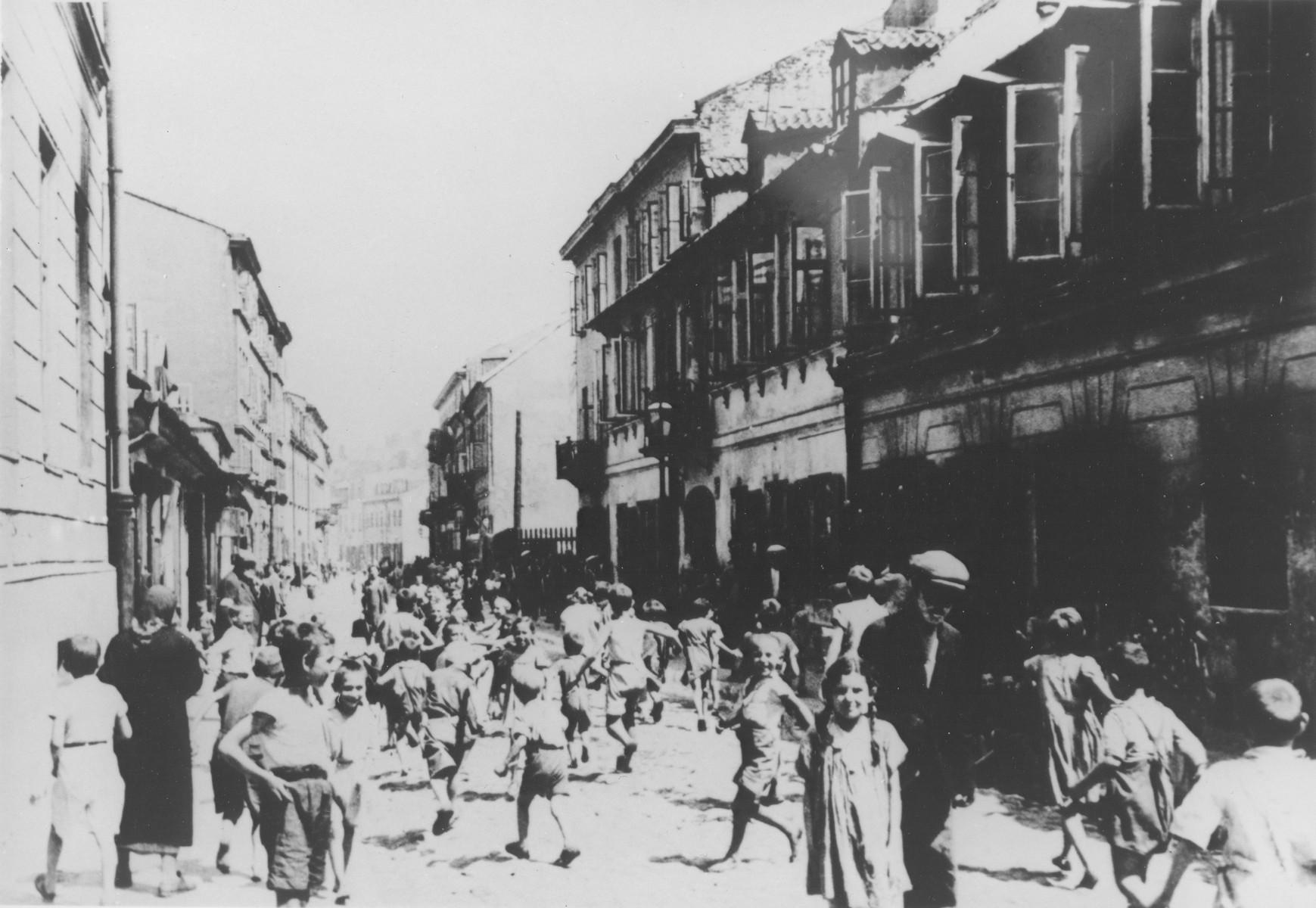 Jewish children playing on Krochmalna Street in the Warsaw ghetto.