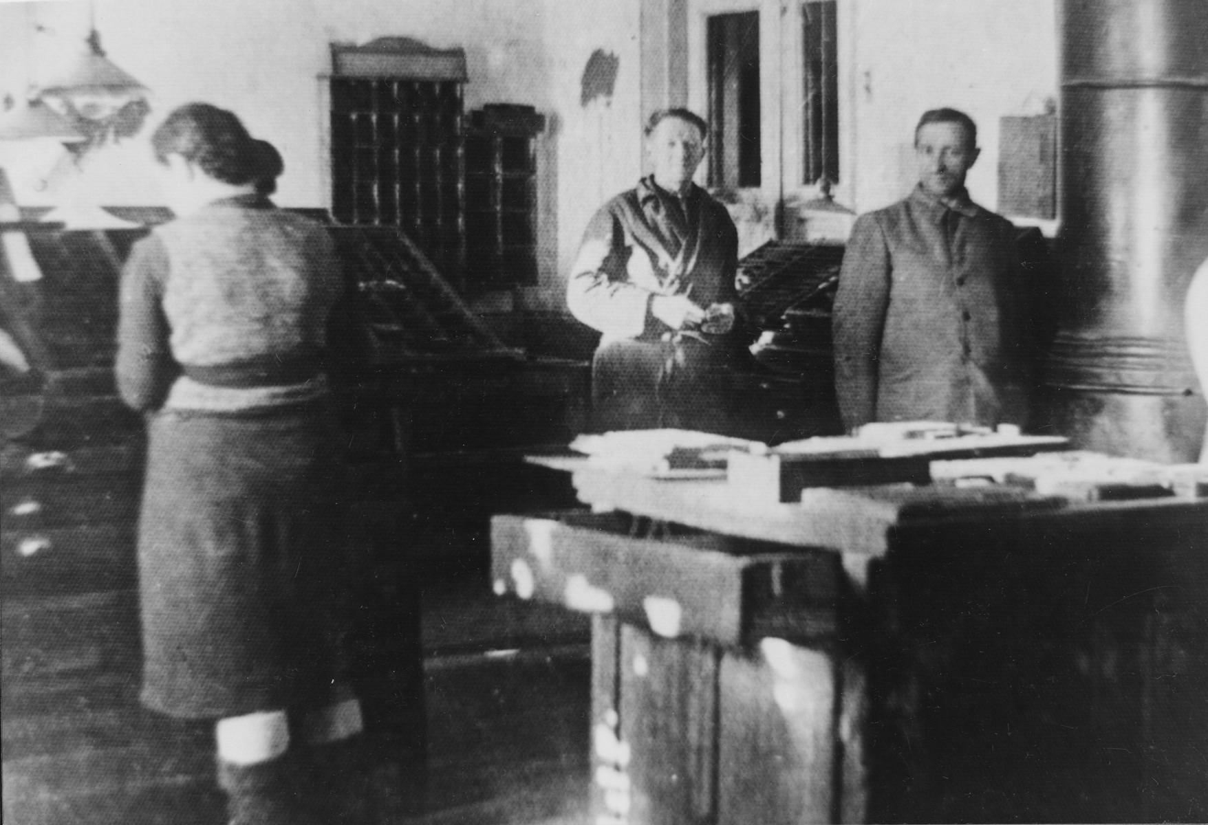 Jews working in a print shop in the Glubokoye ghetto.