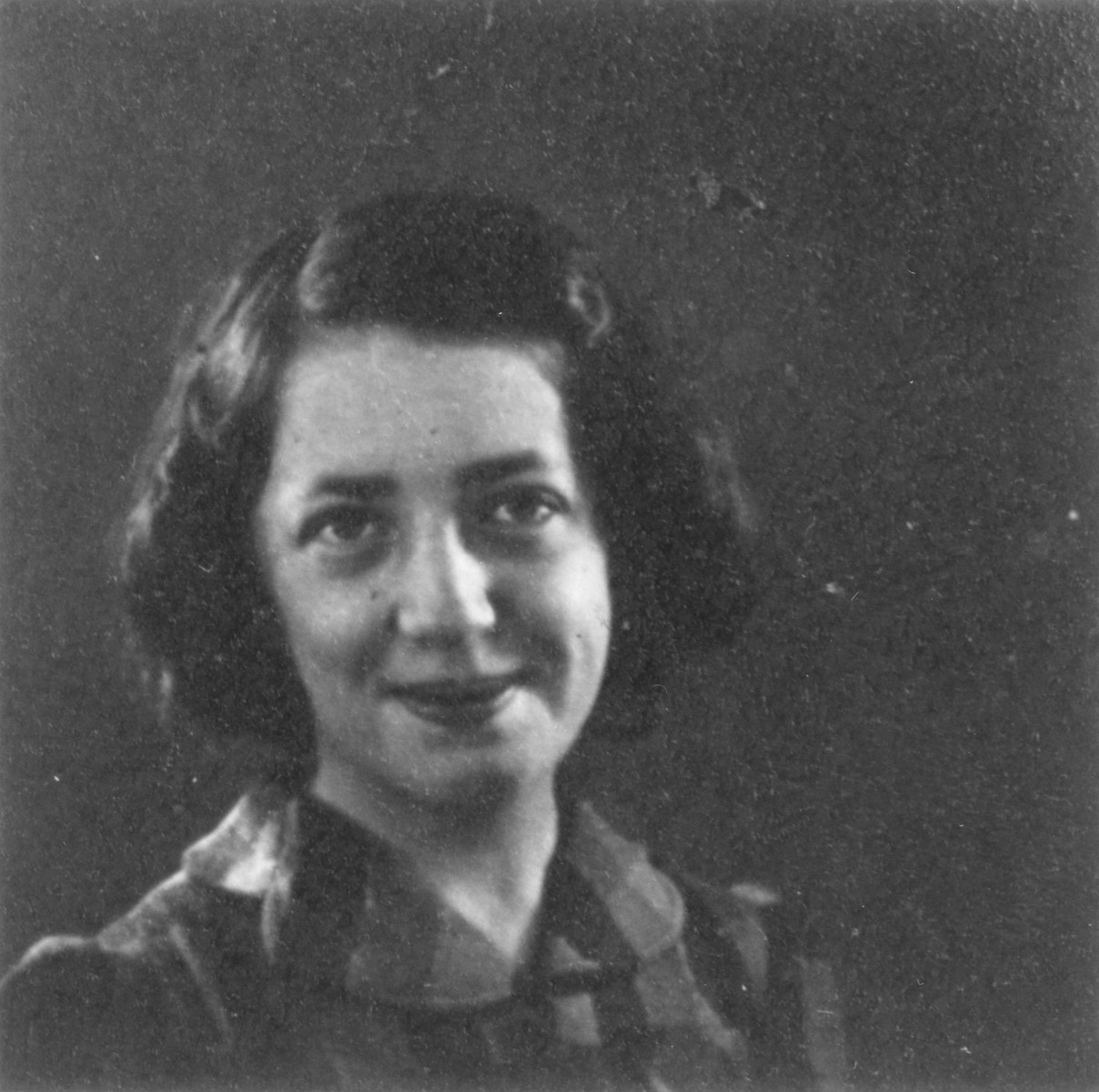 Portrait of Dorrit Trost (b. 1929), the niece of Herma Ellengoghen, as an Austrian-Jewish refugee living in Belgium.  Dorrit and her family were deported and killed in Auschwitz.