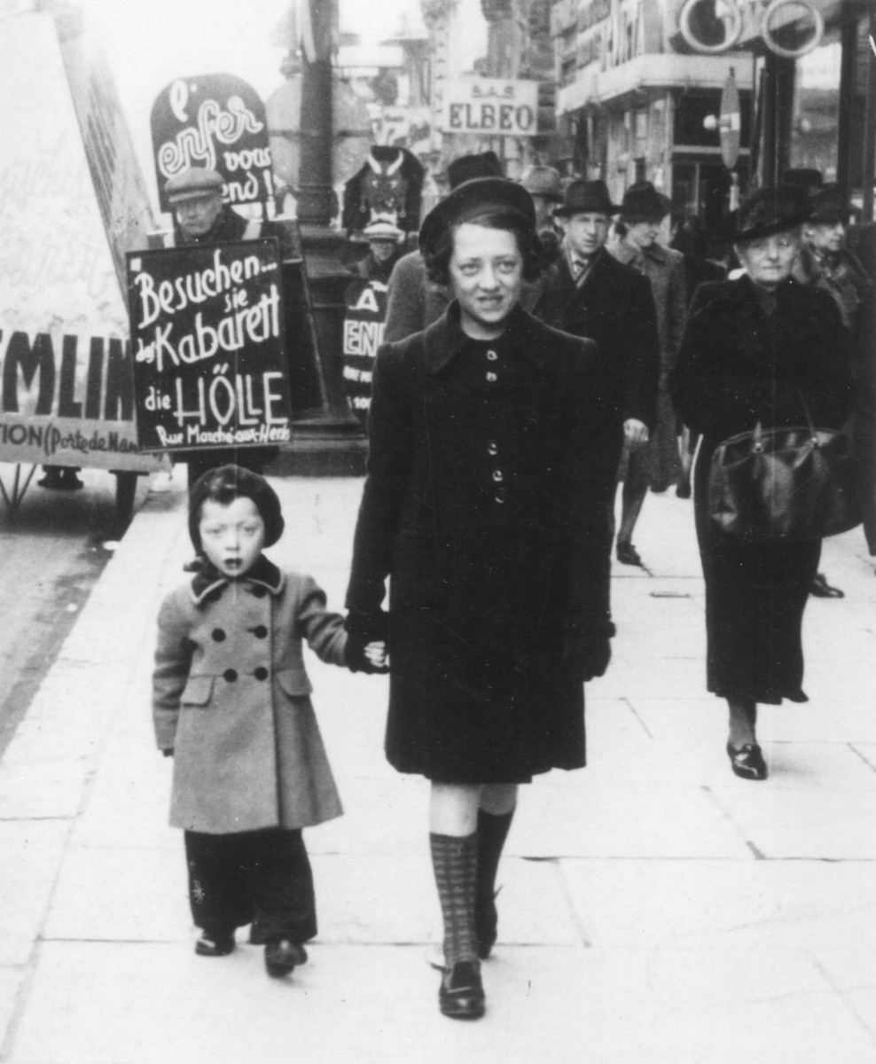 Austrian-Jewish refugees walk along a commercial street in central Brussels.    Pictured are the donor's two nieces, Dorrit and Erika Trost.  The sisters were deported and killed in Auschwitz.