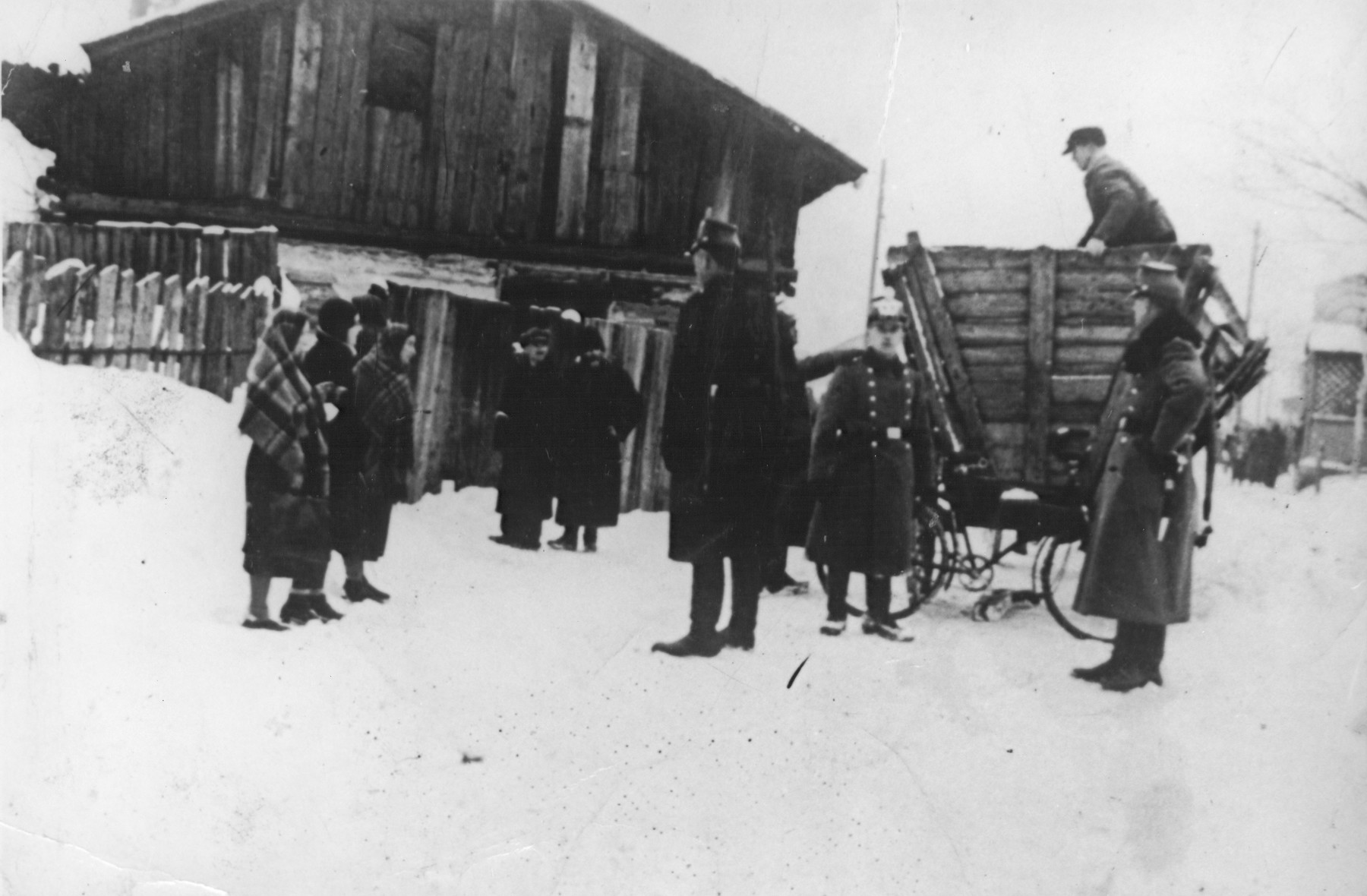 German police round-up Jews for deportation from the Zawiercie ghetto.