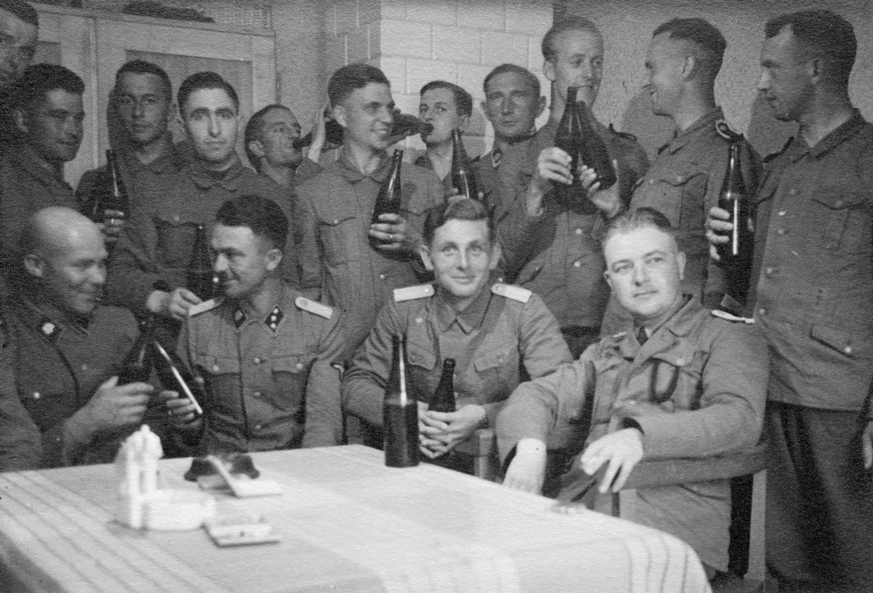 Members of the Waffen-SS enjoy a drink in occupied Poland.