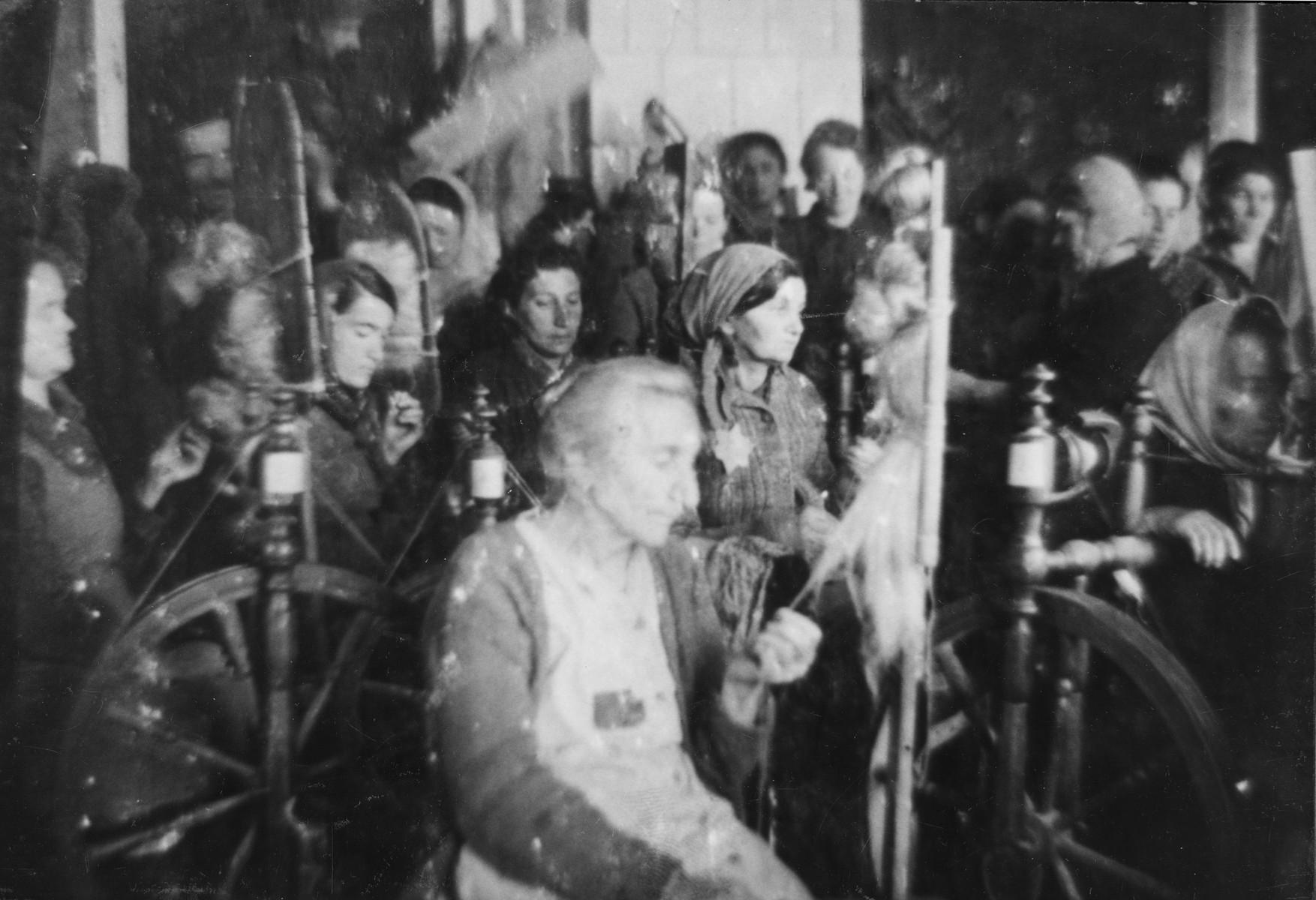 Jewish women at work spinning yarn in the Glubokoye ghetto.