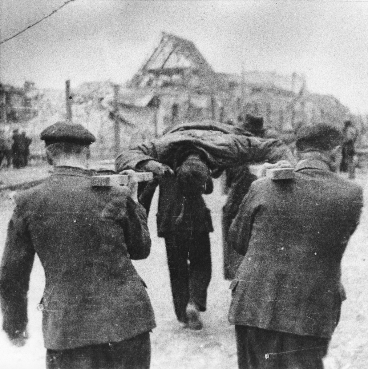 German civilians removing corpses from the Nordhausen concentration camp for burial in mass graves.
