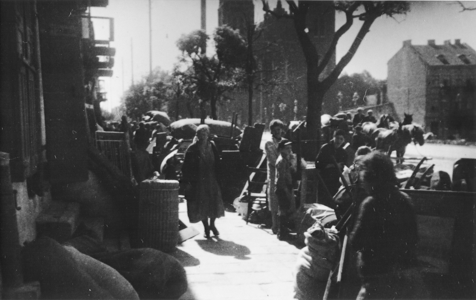 """Piles of furniture and household belongings of Jews who are being transferred to the ghetto cover the pavement of a street in Kutno.  The original German caption reads: """"Evacuation of Kutno. Jews out!"""""""
